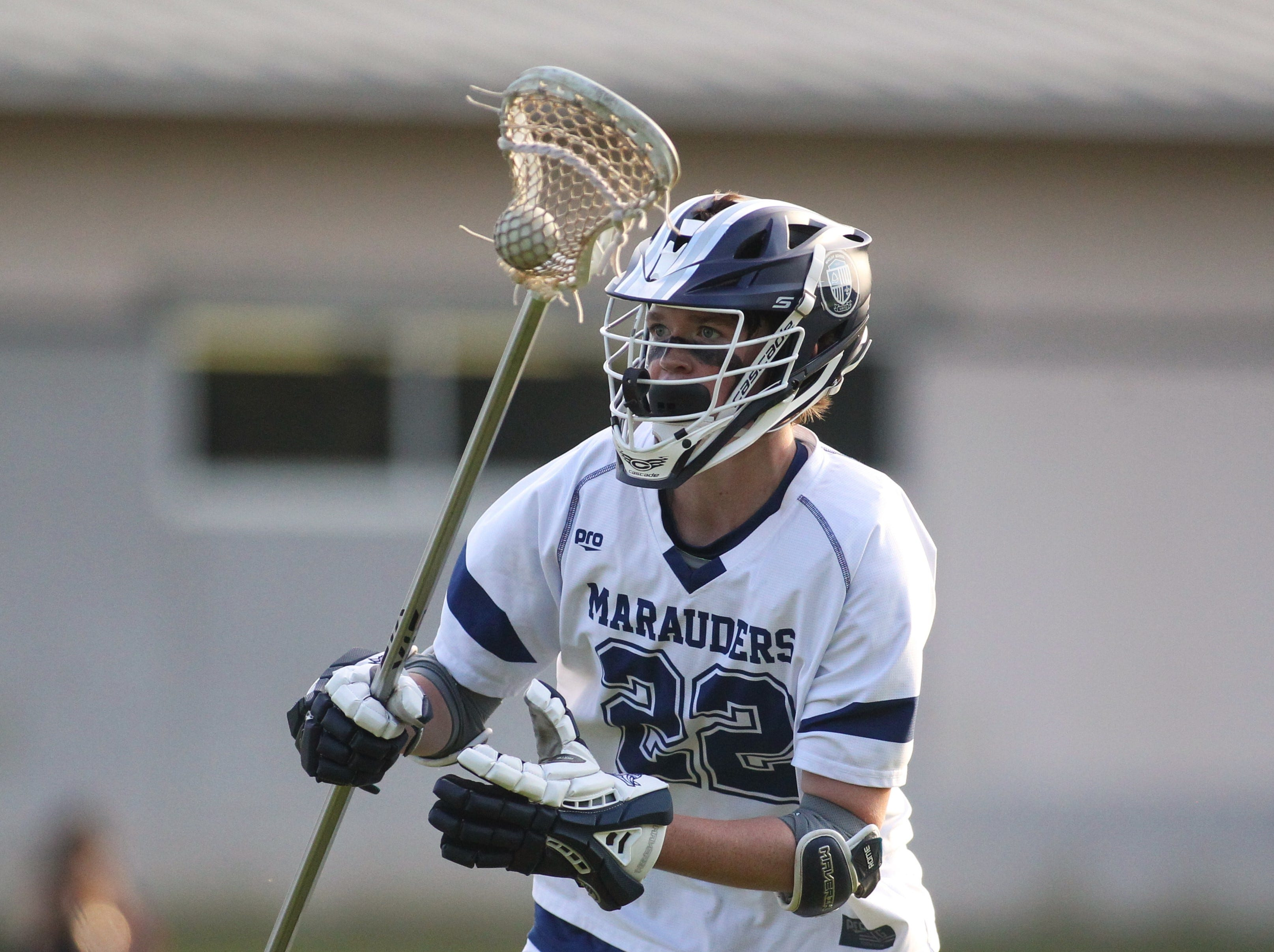 Maclay defender Connor Chason looks for an outlet pass as the Marauders' lacrosse team beat Leon 15-5 on their annual Military Appreciation Night on March 12, 2019.