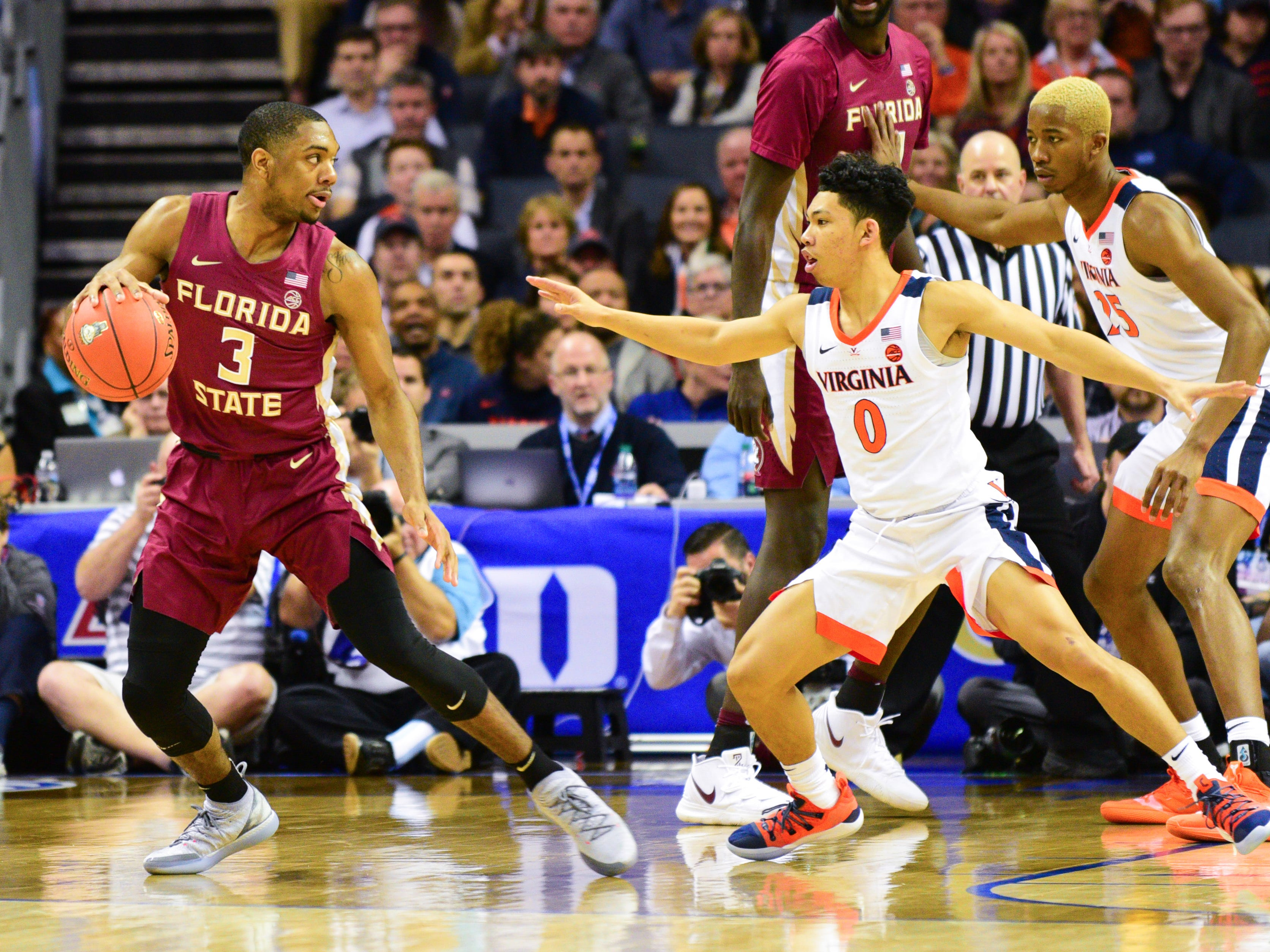 Florida State junior guard Trent Forrestt looks for an opening in the Virginia defense during the first half of the ACC Tournament Semifinals at the Spectrum Center in Charlotte on Friday.