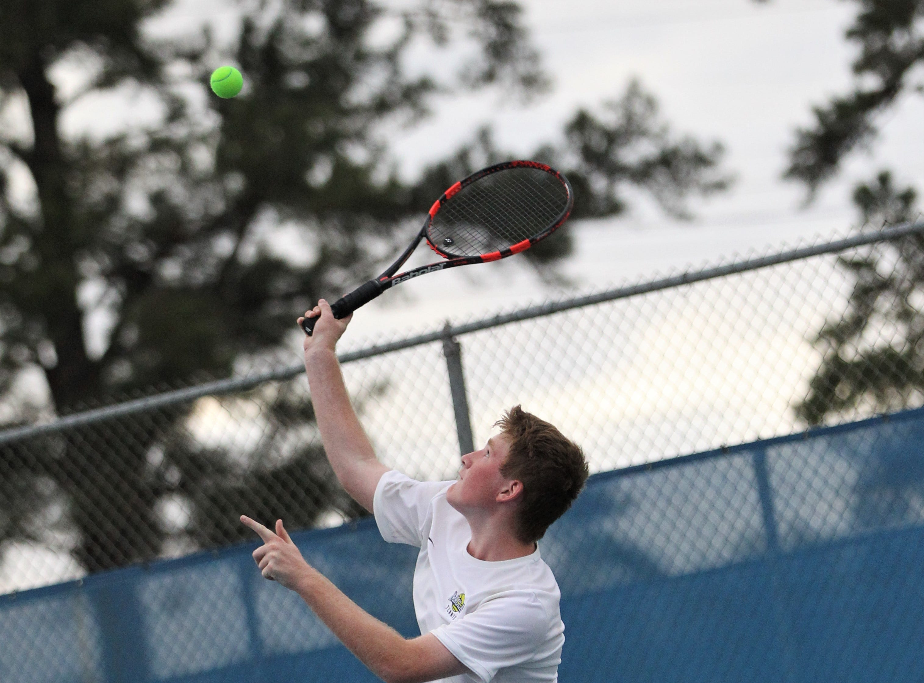 Maclay's Evan Stewart serves during the high school boys and girls city tennis tournament at Tom Brown Park on Thursday, March 14, 2019.