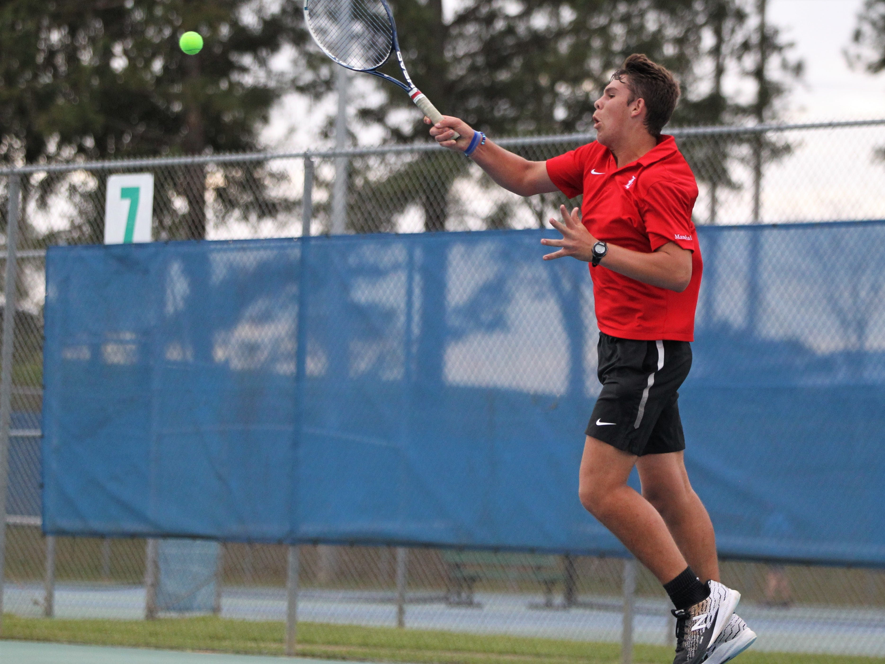 Leon senior Will Bullen hits a forehand plays during the high school boys and girls city tennis tournament at Tom Brown Park on Thursday, March 14, 2019.