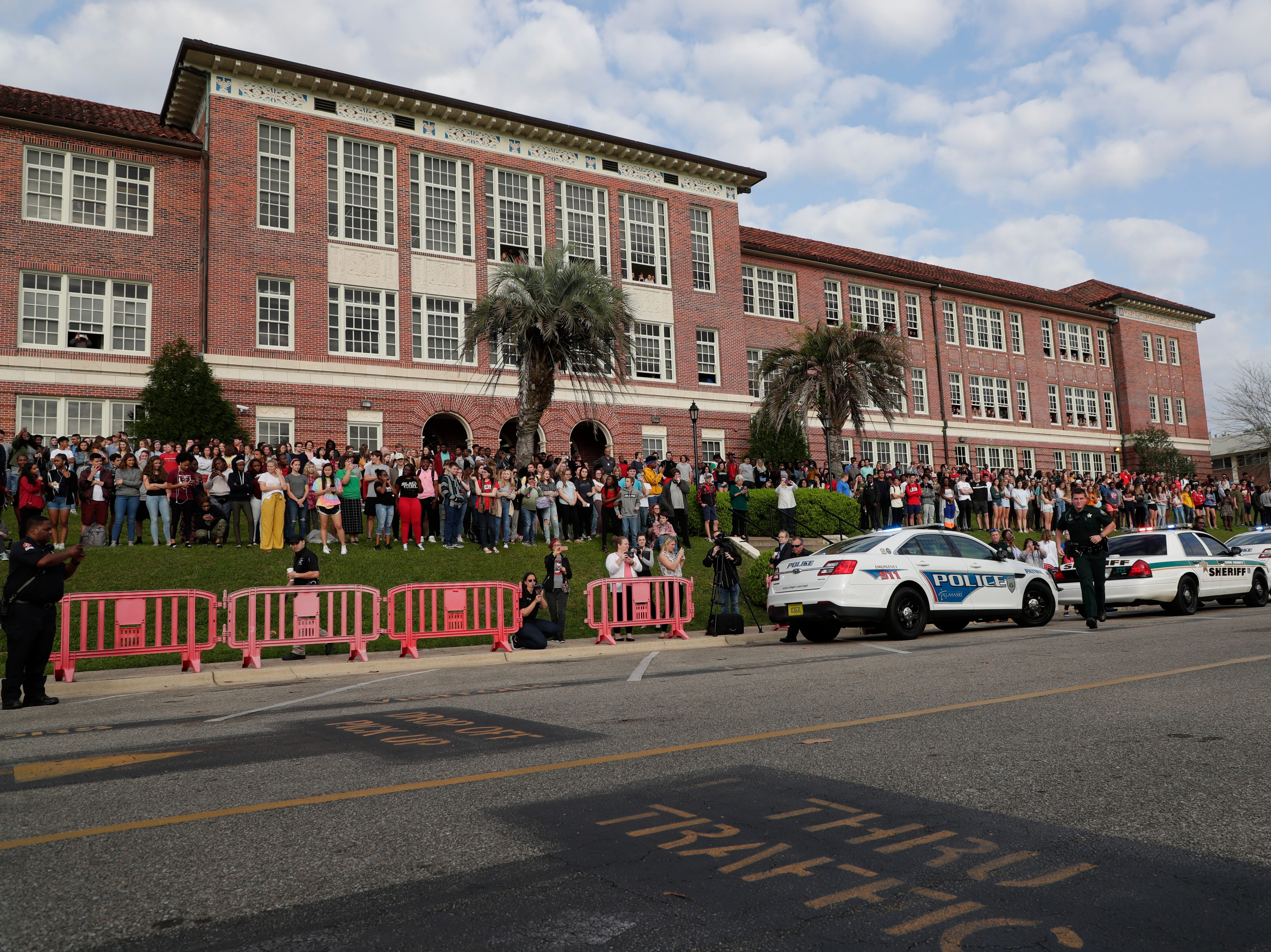 Leon High School students gather on the front lawn to watch as Leon High School partners with the county safety officials to give a simulation on the consequences of drunk driving before the students leave for spring break Friday, March 15, 2019.