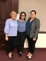 (L-R) Denitsa Kolev, third-year law student at Florida State; Karina Flores, second-year law student and Attorney Caitlyn Kio, graduate fellow, Florida Public Interest Law Center at FSU, stand outside Senate committee room at the Capitol.