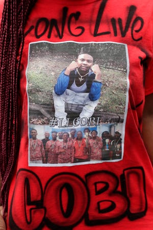 Derreecia Williams shows off her shirt honoring Cobi Mathis Thursday, March 14, 2019. Mathis, 17, was shot and killed in broad daylight in the parking lot of an Old Bainbridge Road daycare Monday, Feb. 25, 2019.