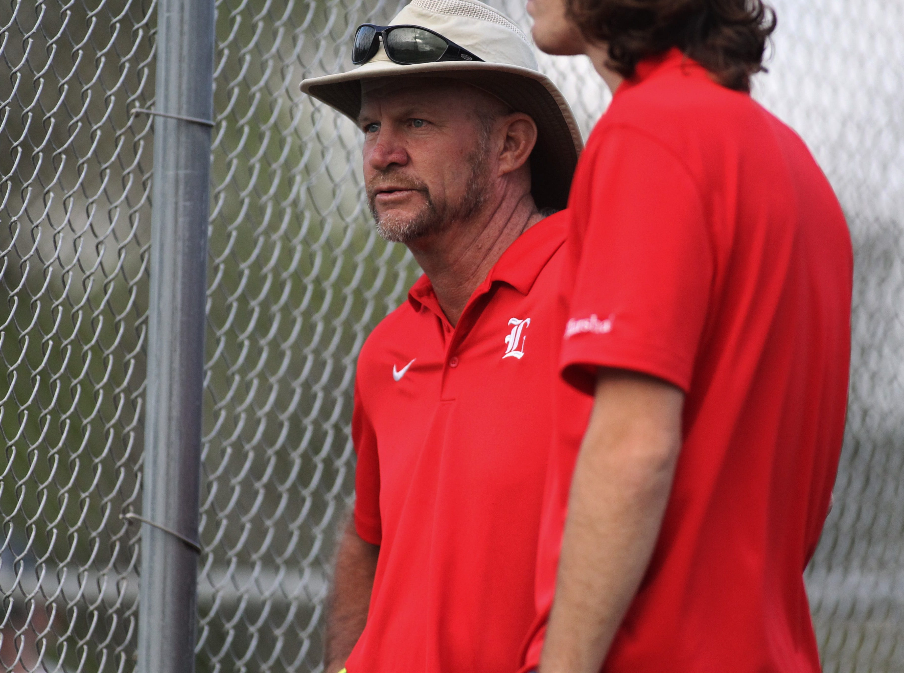 Leon tennis coach Kevin Record watches during the high school boys and girls city tennis tournament at Tom Brown Park on Thursday, March 14, 2019.