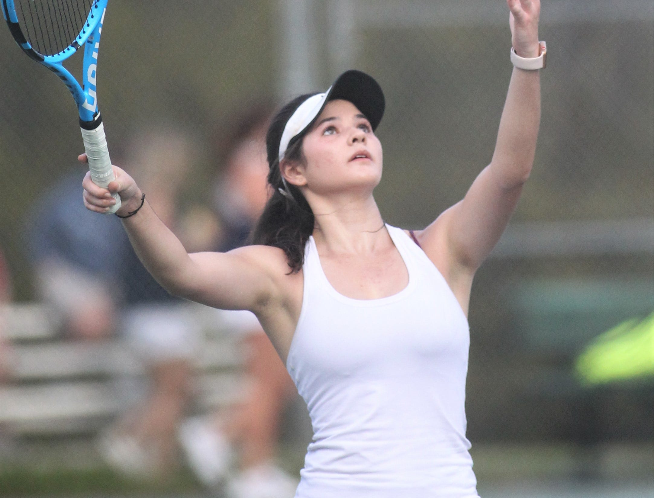 Chiles senior Gracie Wilson serves during the high school boys and girls city tennis tournament at Tom Brown Park on Thursday, March 14, 2019.