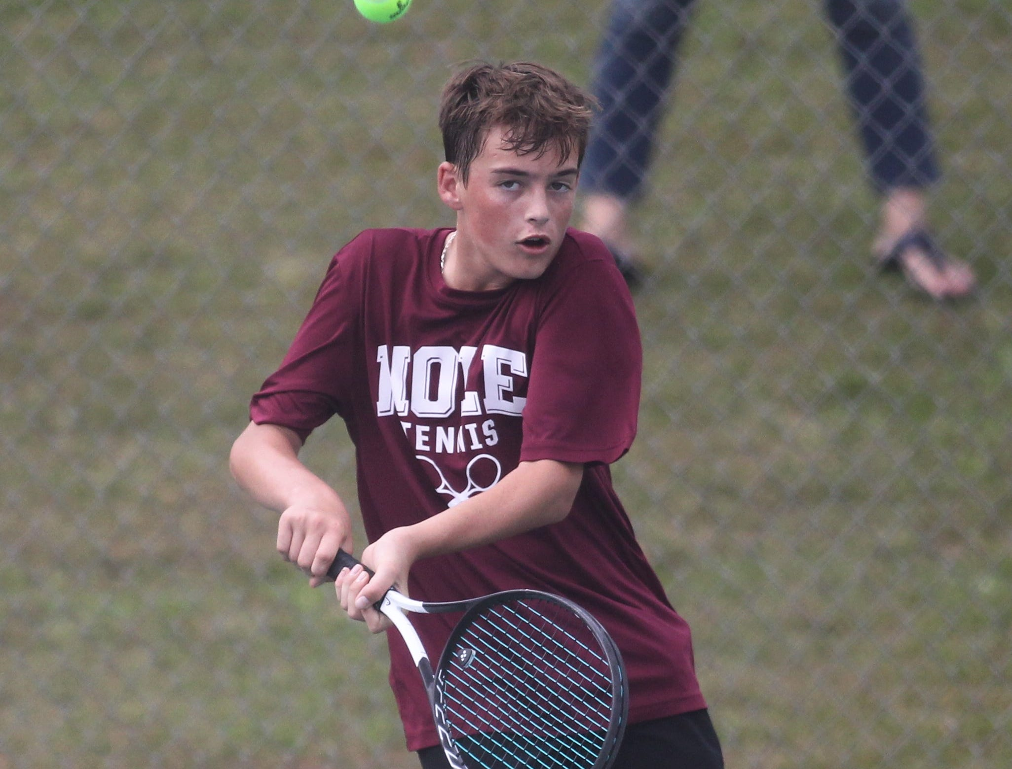 Florida High's Gabe Roane plays during the high school boys and girls city tennis tournament at Tom Brown Park on Thursday, March 14, 2019.