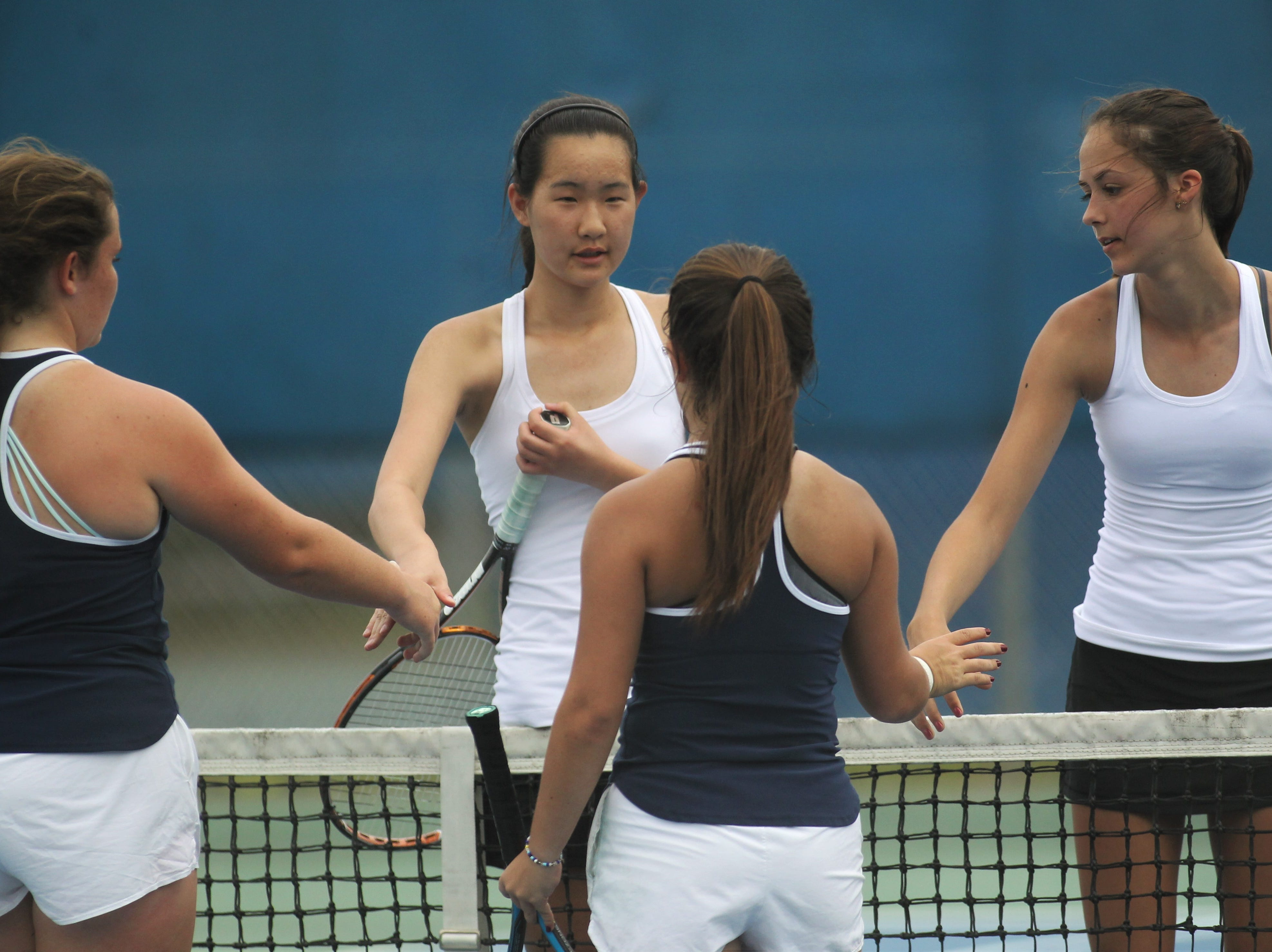 Chiles' Amy Xia and Harli Neshat shake hands after winning a No. 2  doubles match against Maclay's Emily Macri and Bella Snider during the high school boys and girls city tennis tournament at Tom Brown Park on Thursday, March 14, 2019.