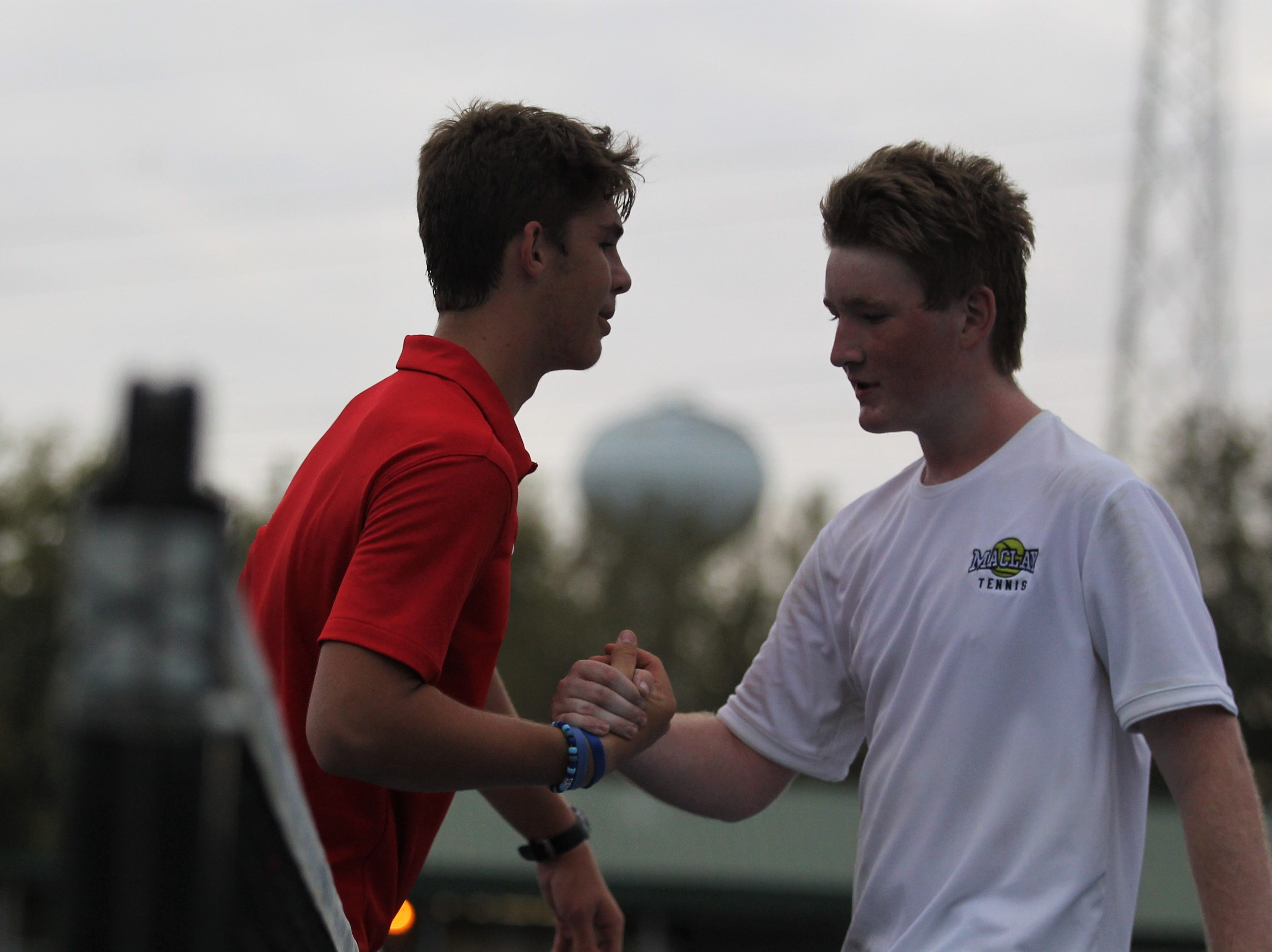 Leon's Will Bullen shakes hands with Maclay's Evan Stewart after winning a match during the high school boys and girls city tennis tournament at Tom Brown Park on Thursday, March 14, 2019.