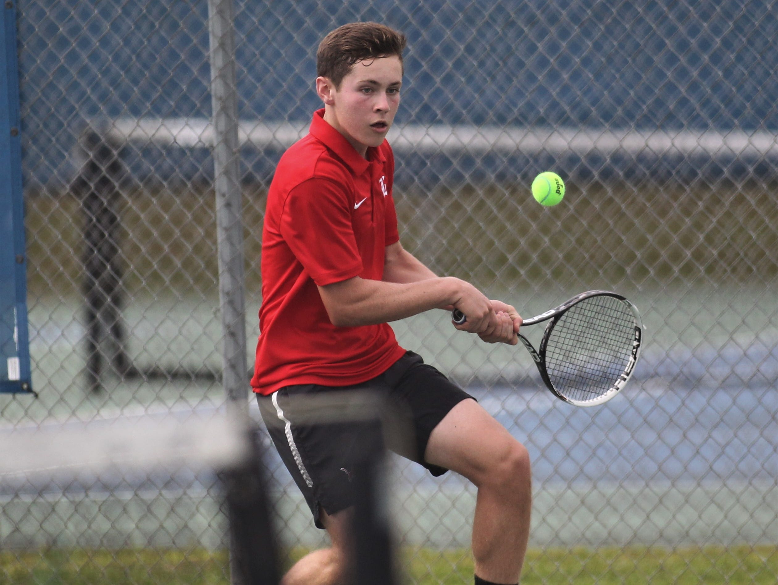 Leon sophomore Jack Long plays during the high school boys and girls city tennis tournament at Tom Brown Park on Thursday, March 14, 2019.