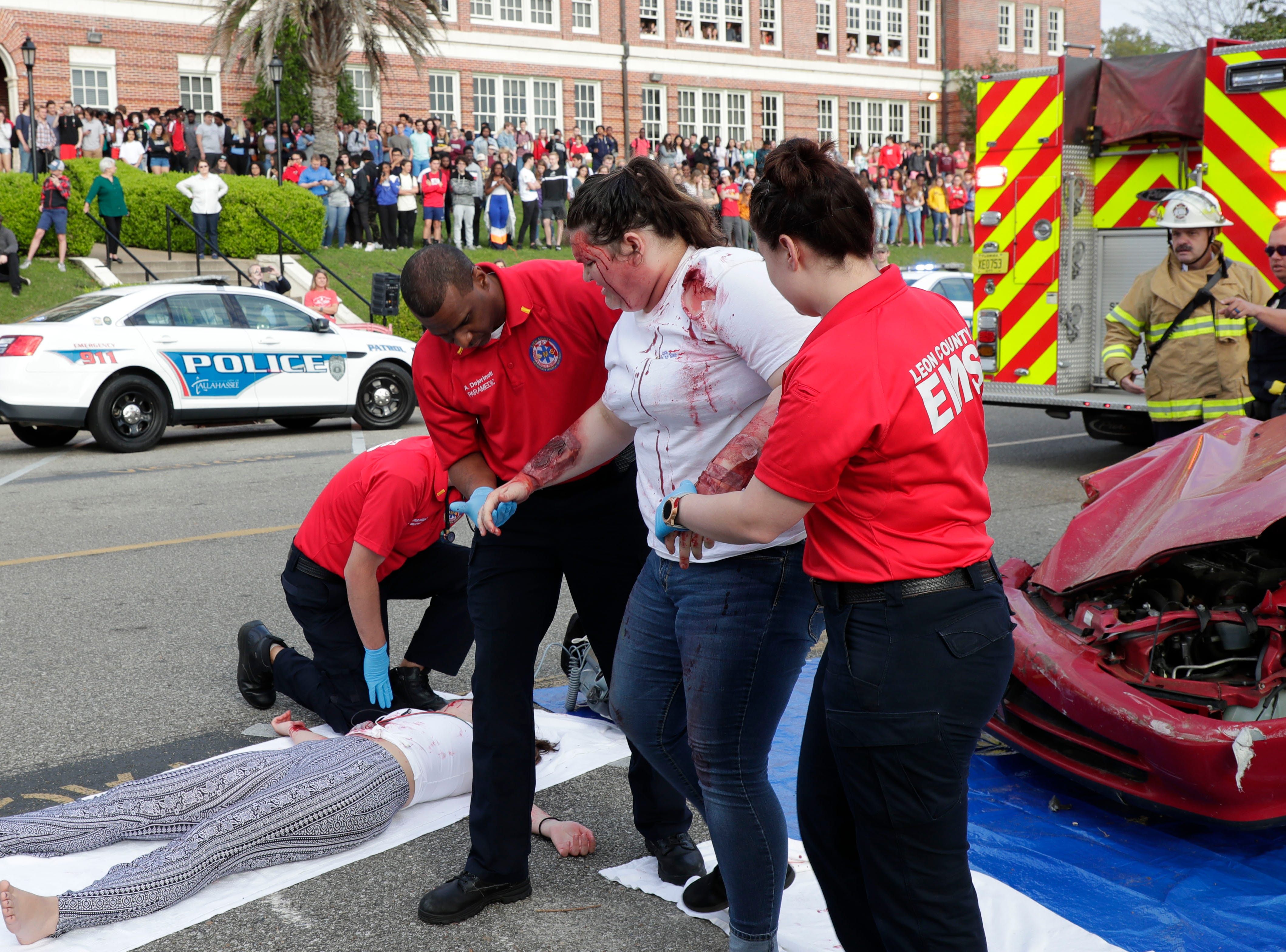 Caitlyn Burke is taken to an ambulance by Leon County EMS paramedics. Leon High School partners with the county safety officials to give a simulation on the consequences of drunk driving before the students leave for spring break Friday, March 15, 2019.