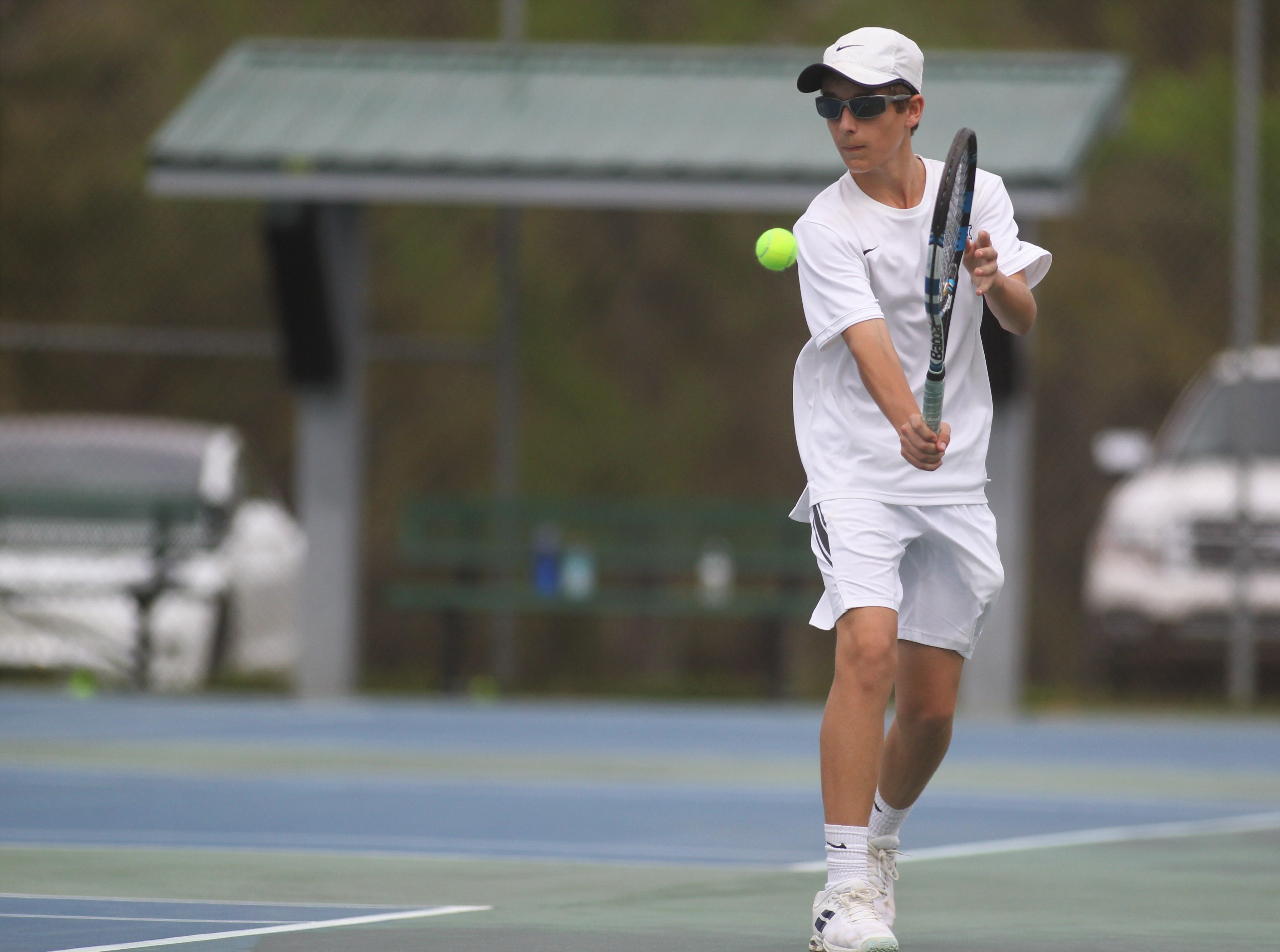 Maclay's Michael Sweeney plays during the high school boys and girls city tennis tournament at Tom Brown Park on Thursday, March 14, 2019.
