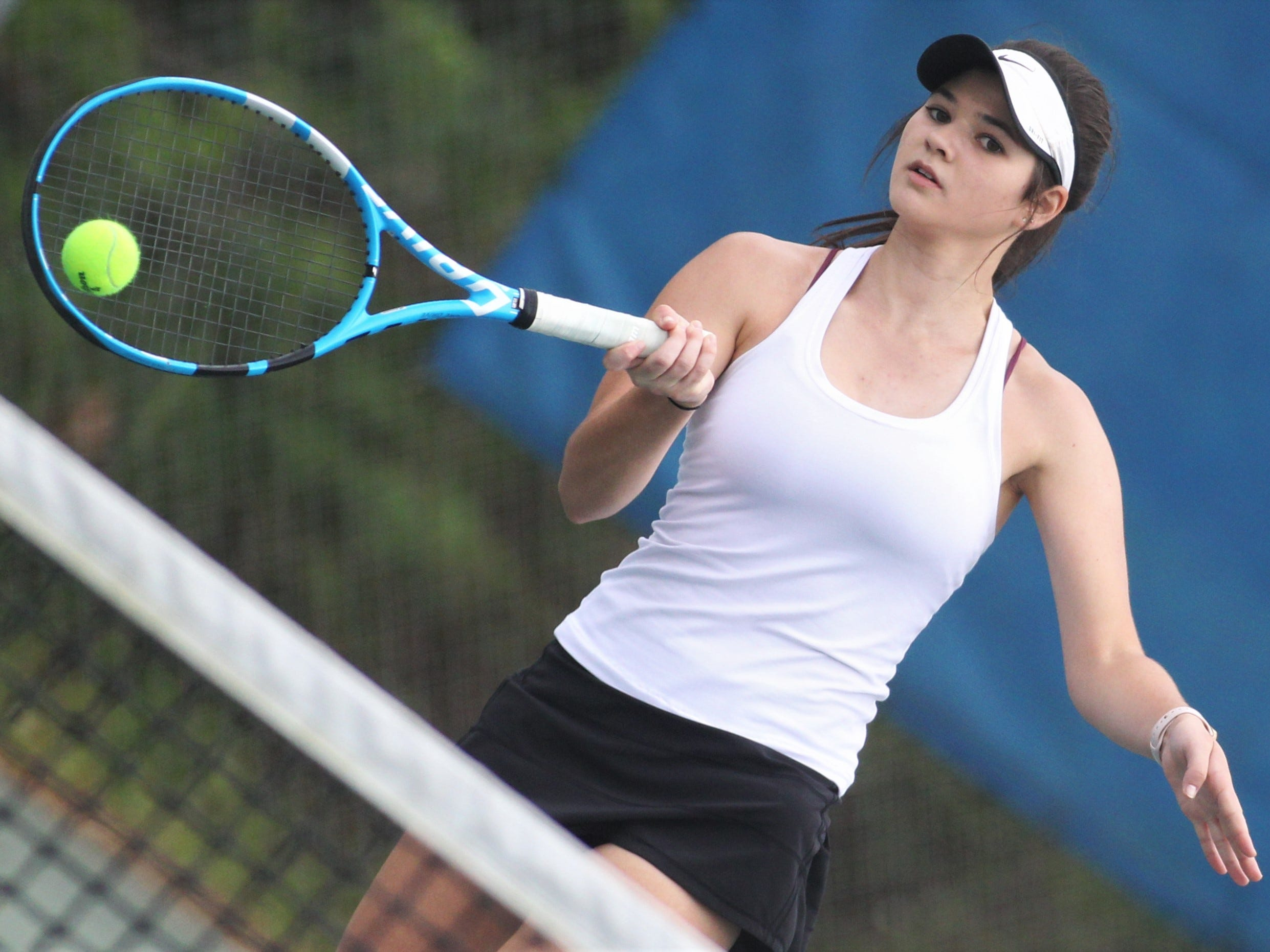 Chiles senior Gracie Wilson hits a forehand during the high school boys and girls city tennis tournament at Tom Brown Park on Thursday, March 14, 2019.