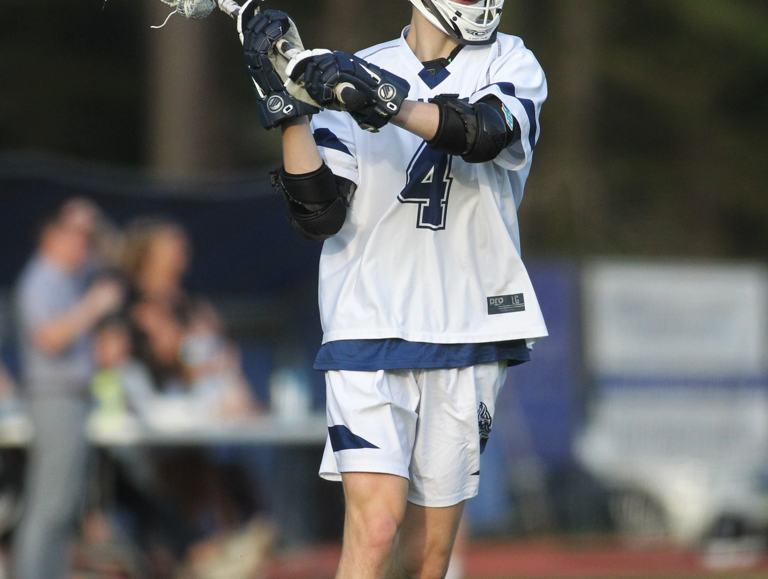 Maclay sophomore Stone Foster looks for a pass as the Marauders' lacrosse team beat Leon 15-5 on their annual Military Appreciation Night on March 12, 2019.