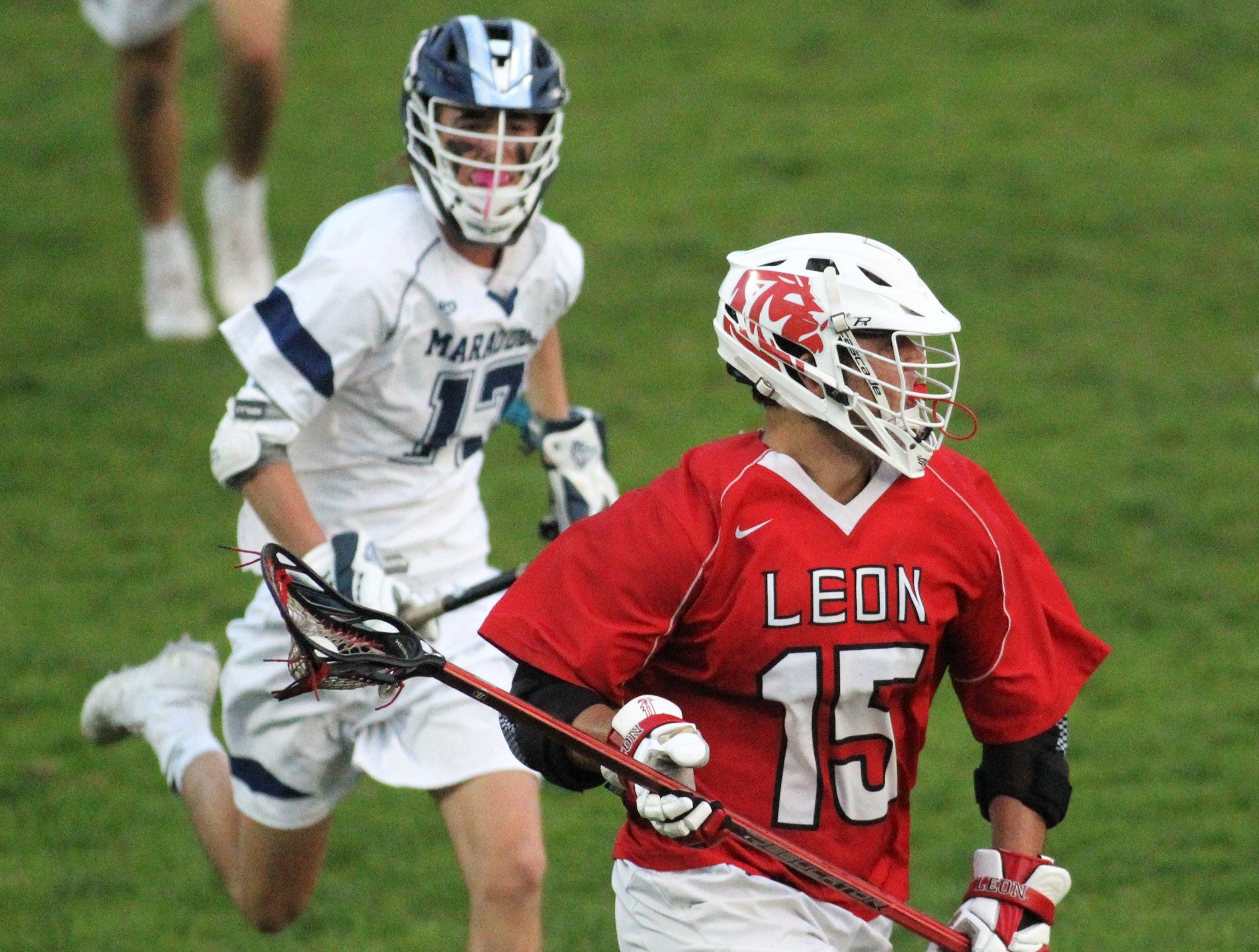 Leon defender Teddy Kirk tries to clear a ball as the Marauders' lacrosse team beat Leon 15-5 on their annual Military Appreciation Night on March 12, 2019.