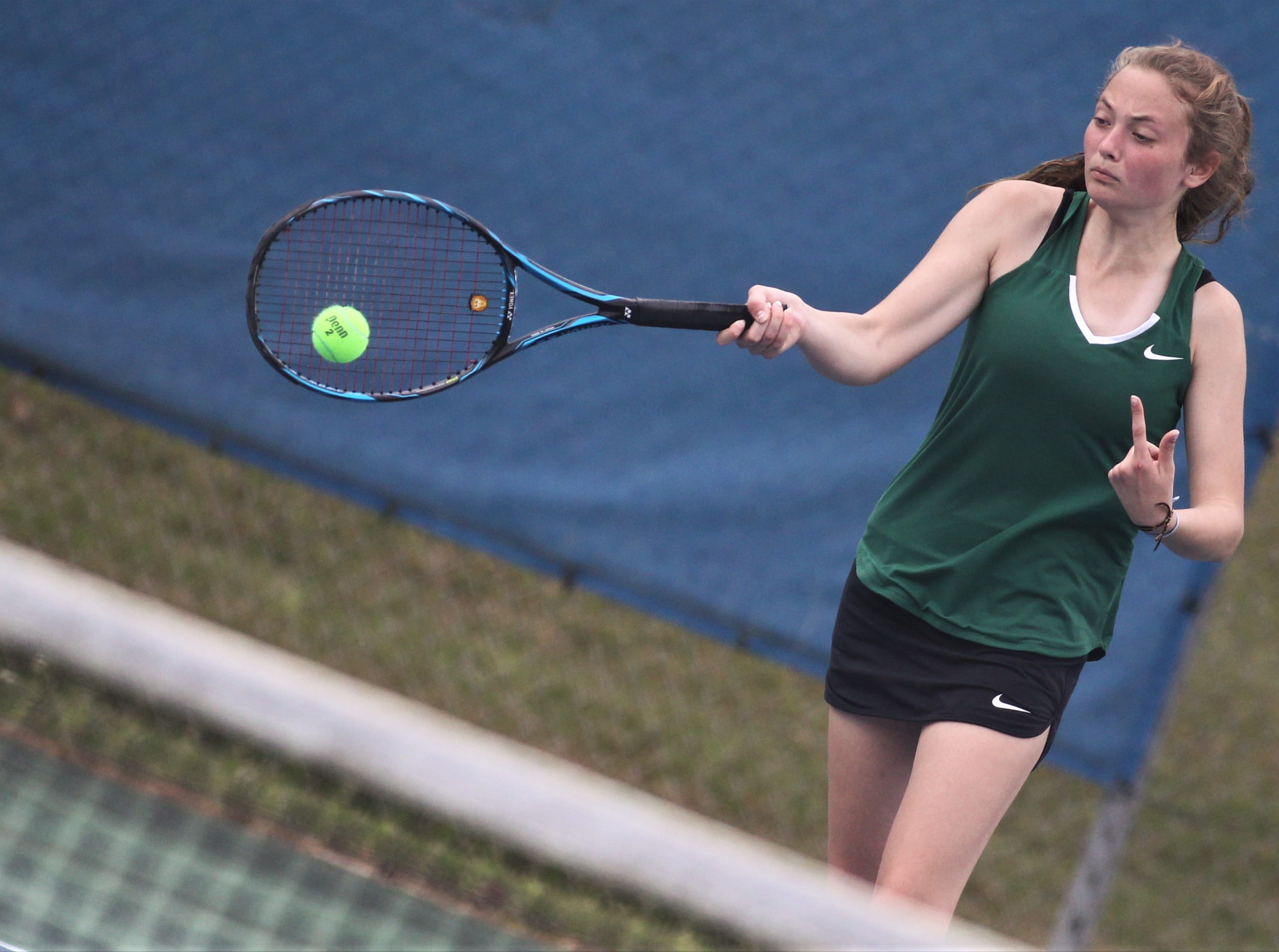 Lincoln's Abby Massey hits a forehand during during the high school boys and girls city tennis tournament at Tom Brown Park on Thursday, March 14, 2019.