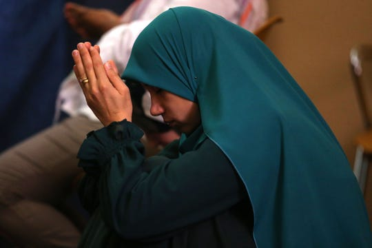 Hala Muhamed bows her head in prayer during a Friday prayer service at the Islamic Center of Tallahassee, March 15, 2019.