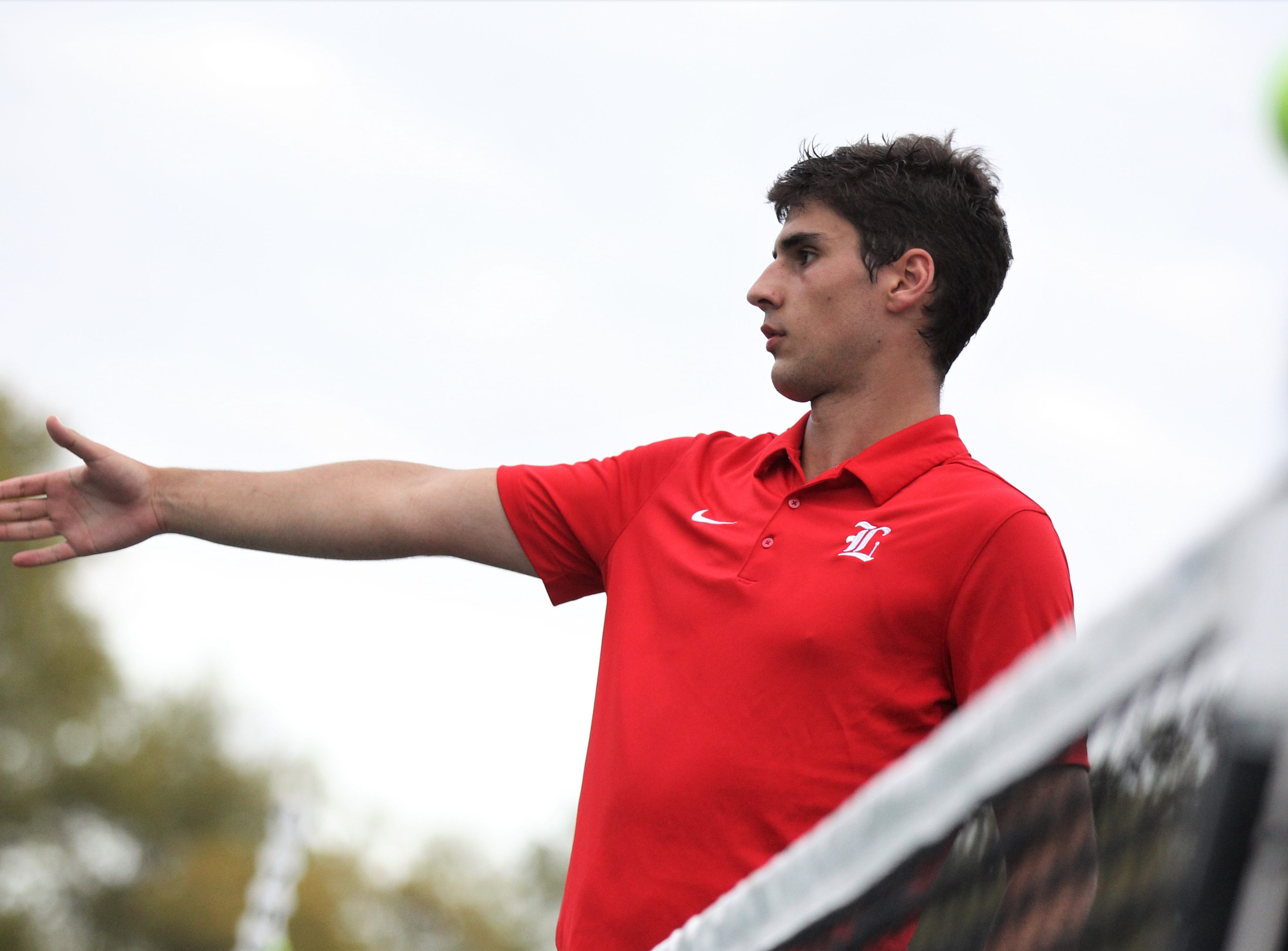 Leon's Petar Leontikj extends his hand for a post-match handshake after winning during the high school boys and girls city tennis tournament at Tom Brown Park on Thursday, March 14, 2019.
