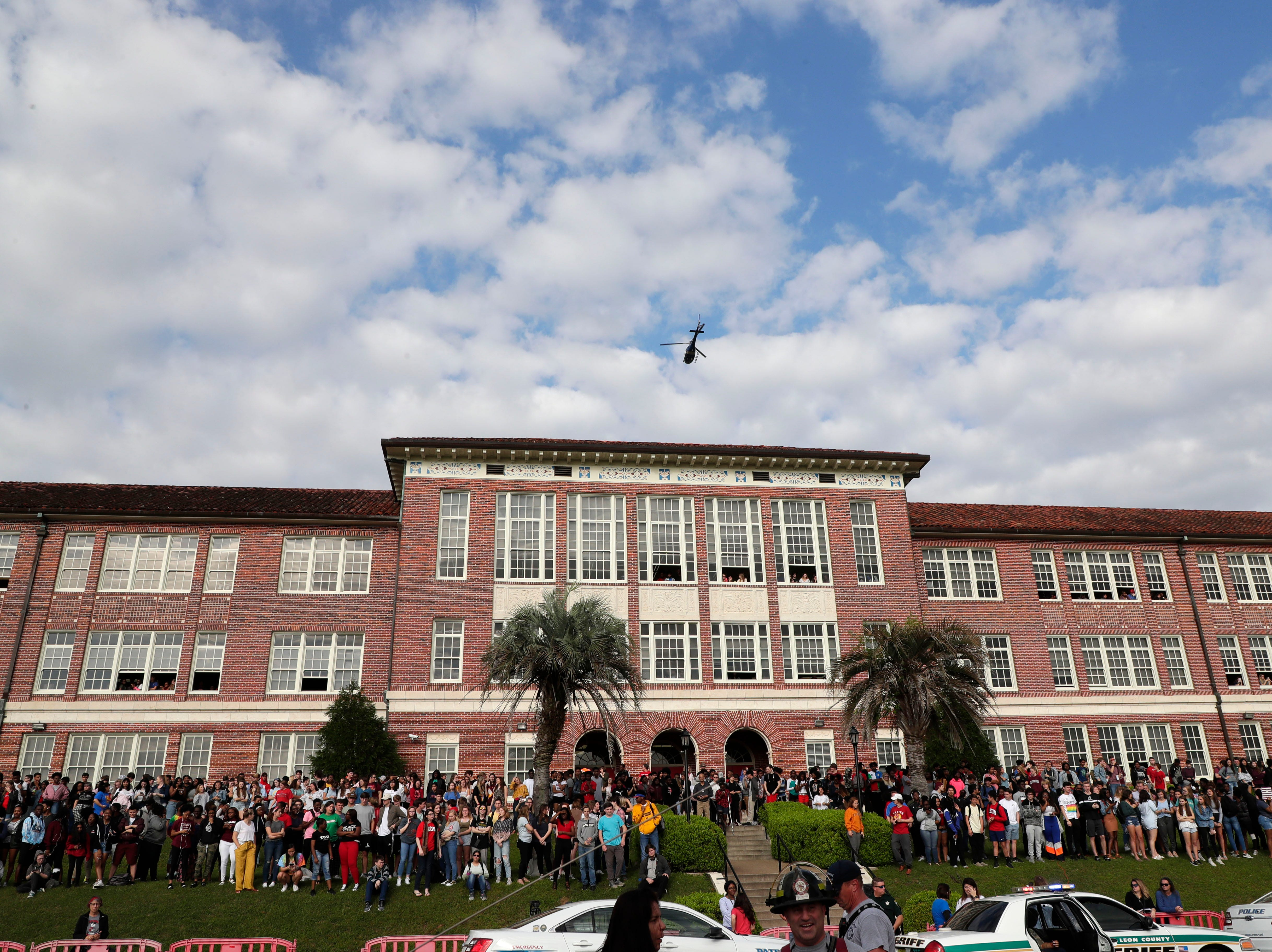A helicopter leaves Leon High School as students watch as Leon High School partners with the county safety officials to give a simulation on the consequences of drunk driving before the students leave for spring break Friday, March 15, 2019.