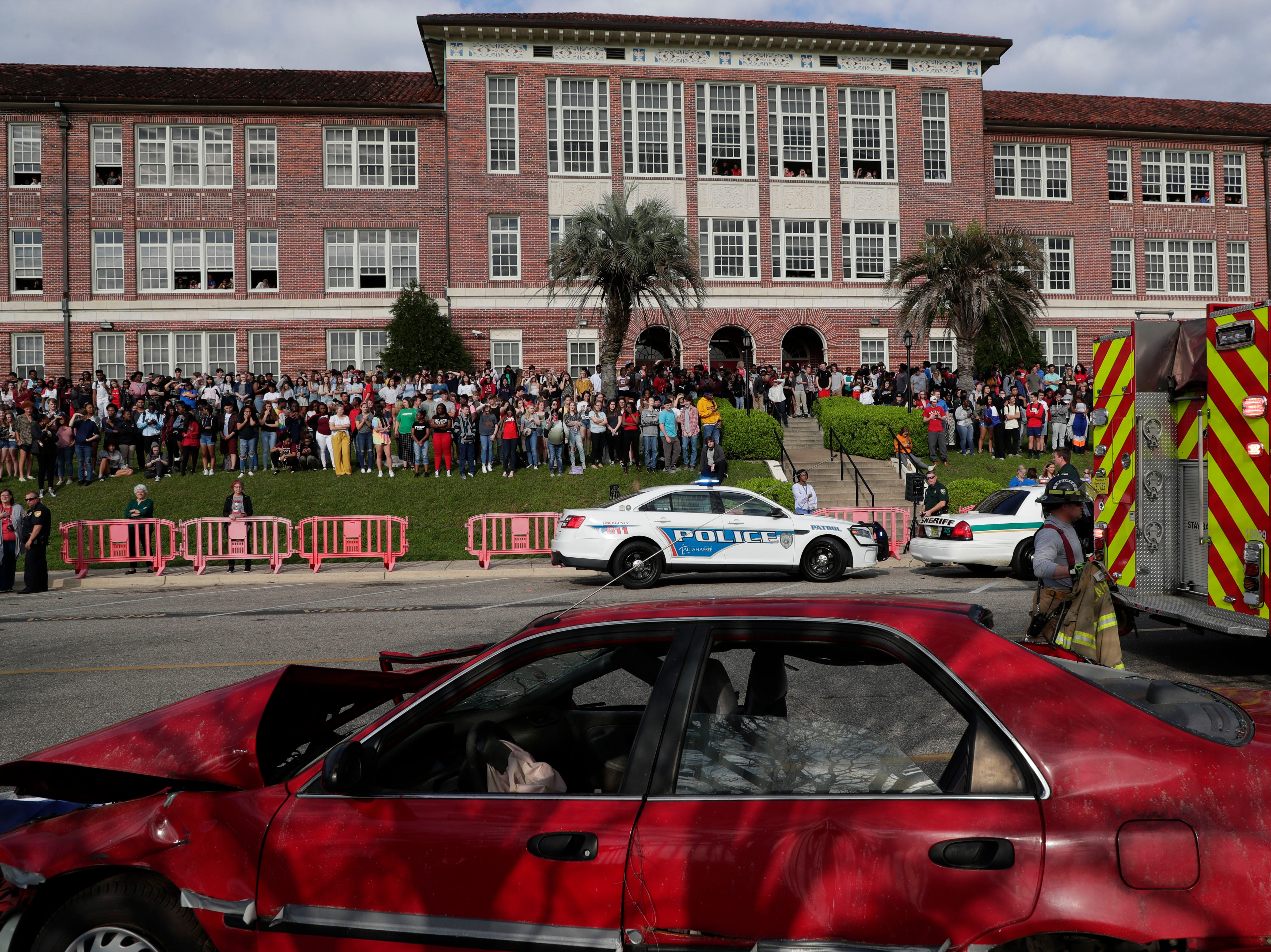 Hundreds of students fill the lawn of Leon High School to watch as Leon High School partners with the county safety officials to give a simulation on the consequences of drunk driving before the students leave for spring break Friday, March 15, 2019.