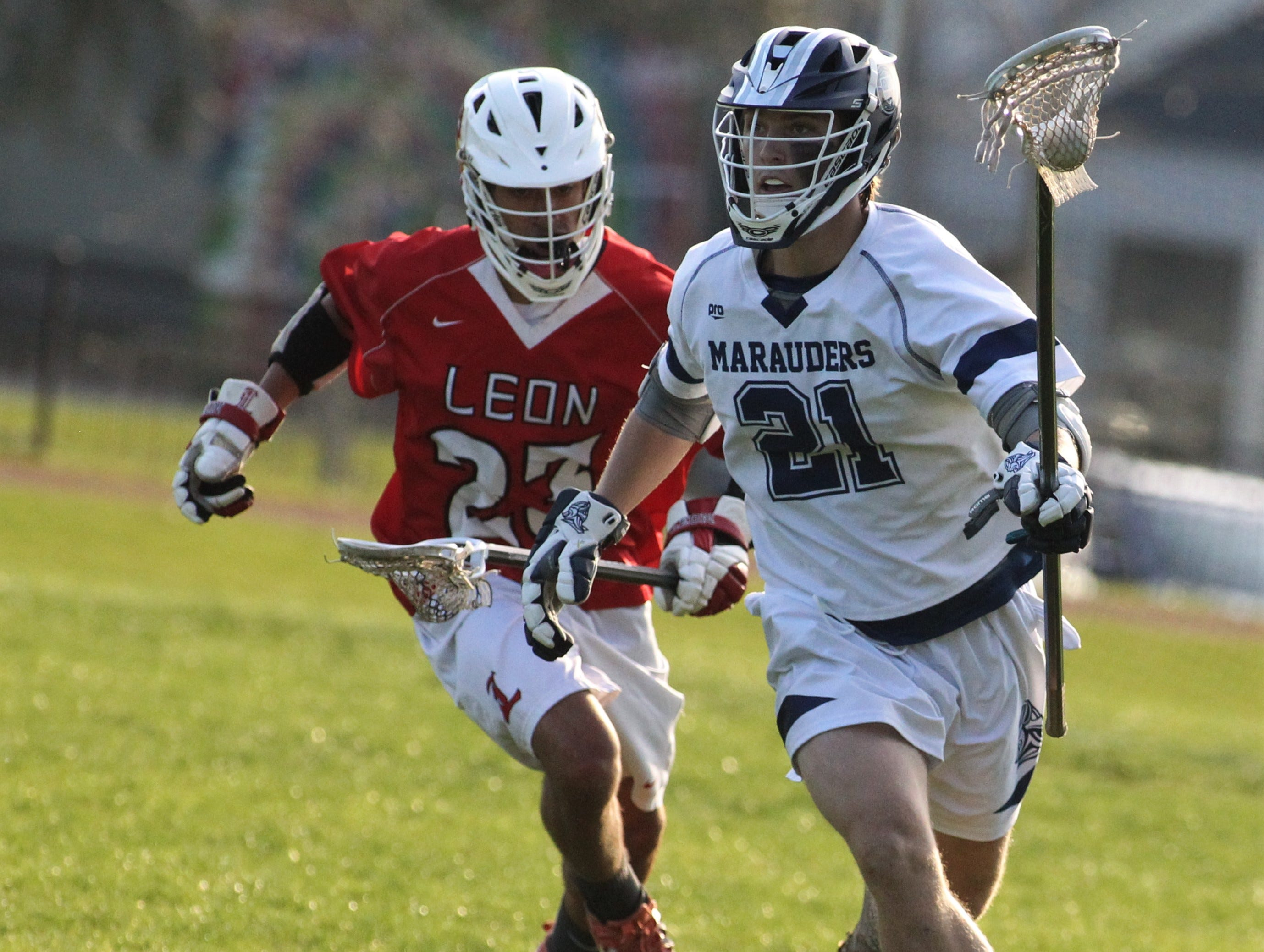 Maclay defender Mark Scott carries upfield as the Marauders' lacrosse team beat Leon 15-5 on their annual Military Appreciation Night on March 12, 2019.