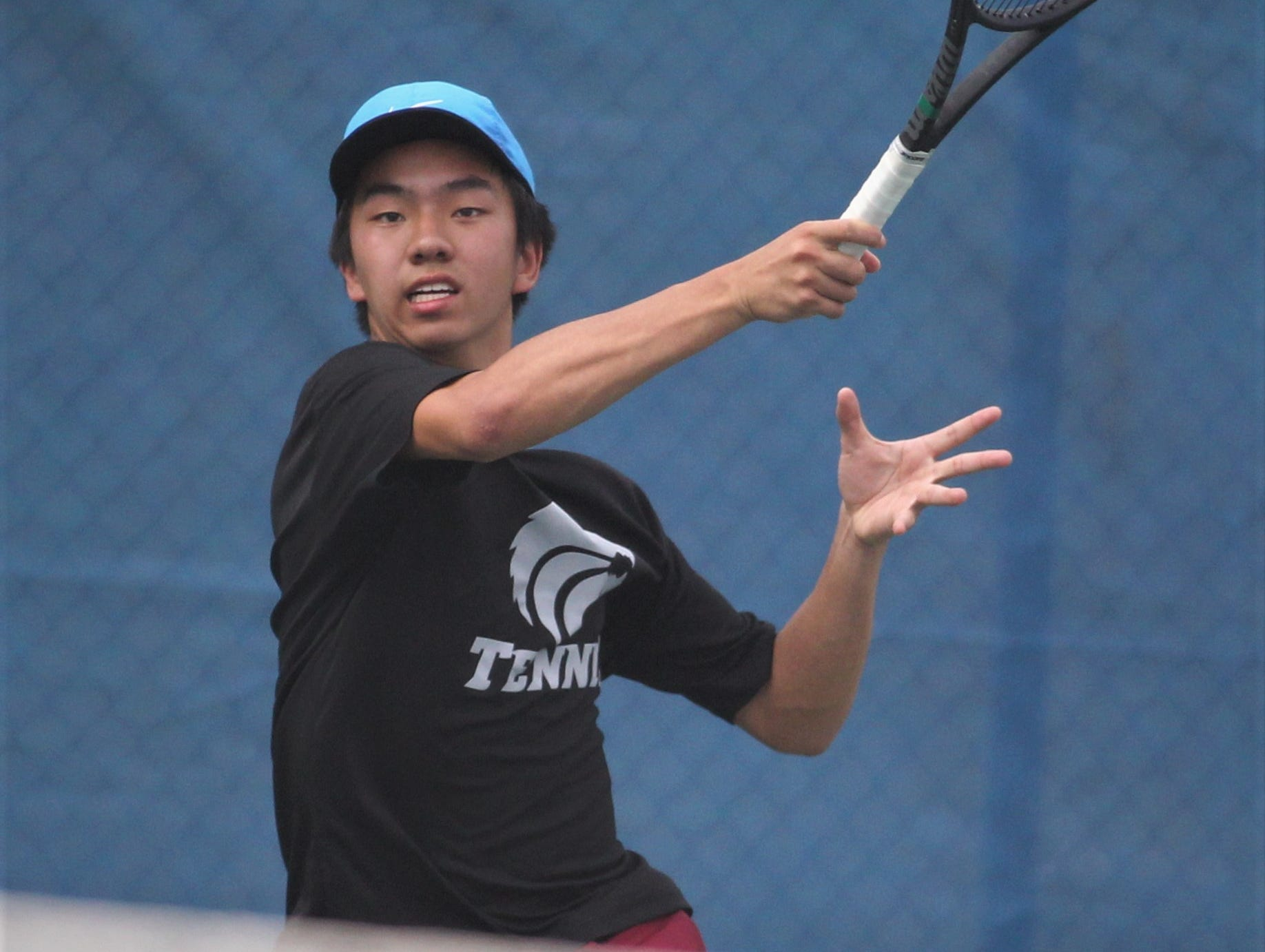 Chiles freshman Brighton Jiang plays during the high school boys and girls city tennis tournament at Tom Brown Park on Thursday, March 14, 2019.