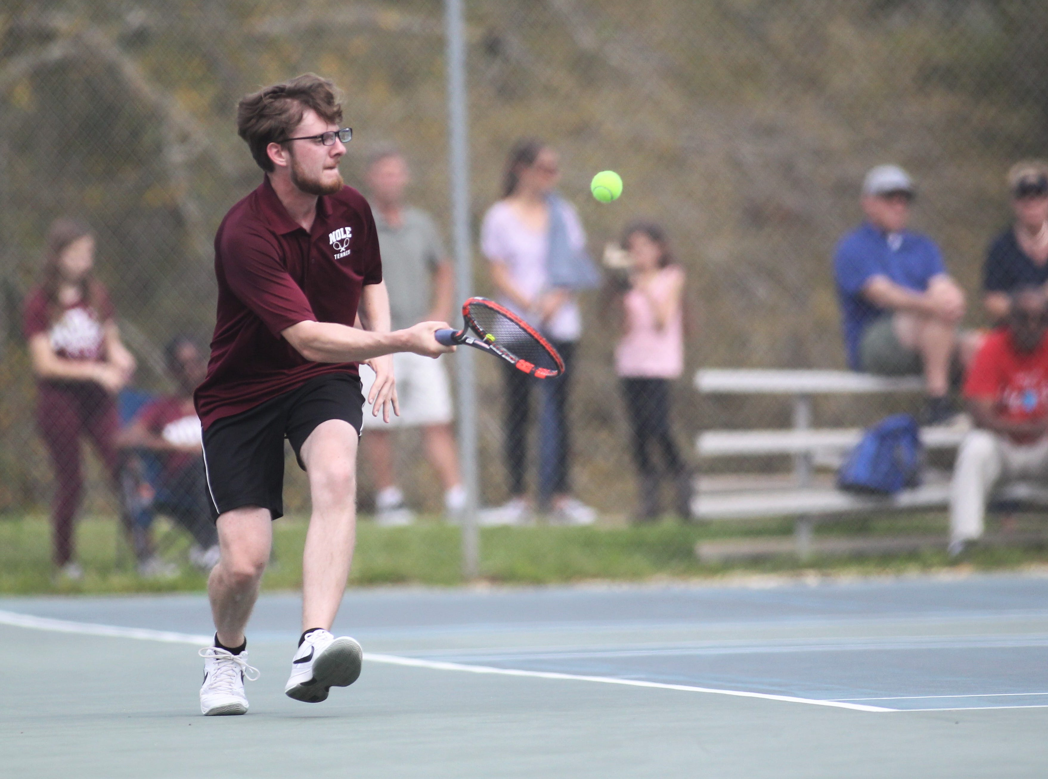 Florida High plays during the high school boys and girls city tennis tournament at Tom Brown Park on Thursday, March 14, 2019.