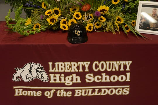 A Liberty County baseball helmet is displayed at a memorial service held for Corey and Shana Crum at the Veterans Memorial Civic Center in Bristol, Fla. Friday, March 15, 2019. The couple died after being electrocuted at the Liberty County High School baseball field Sunday, March 10, 2019.
