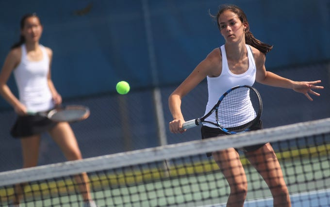 Chiles sophomroe Harli Neshat plays doubles during the high school boys and girls city tennis tournament at Tom Brown Park on Thursday, March 14, 2019.