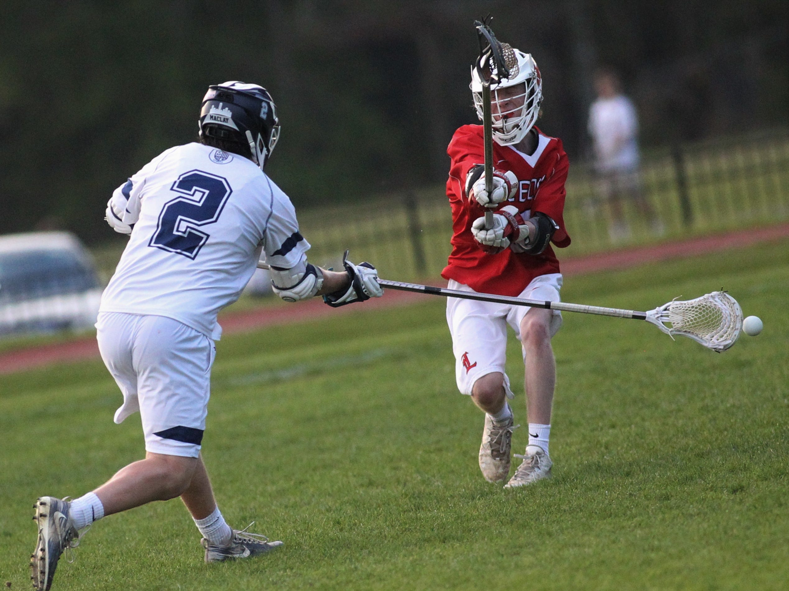 Maclay junior Sam Chase rips a shot for a goal with a long stick as the Marauders' lacrosse team beat Leon 15-5 on their annual Military Appreciation Night on March 12, 2019.