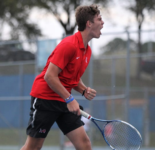 Leon senior Will Bullen celebrates a game point during the high school boys and girls city tennis tournament at Tom Brown Park on Thursday, March 14, 2019.