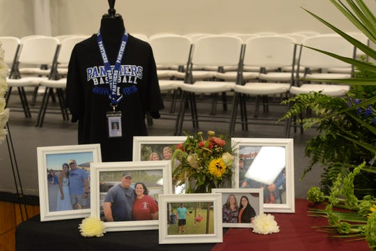 Photos are displayed at a memorial service held for Corey and Shana Crum at the Veterans Memorial Civic Center in Bristol, Fla. Friday, March 15, 2019. The couple died after being electrocuted at the Liberty County High School baseball field Sunday, March 10, 2019.