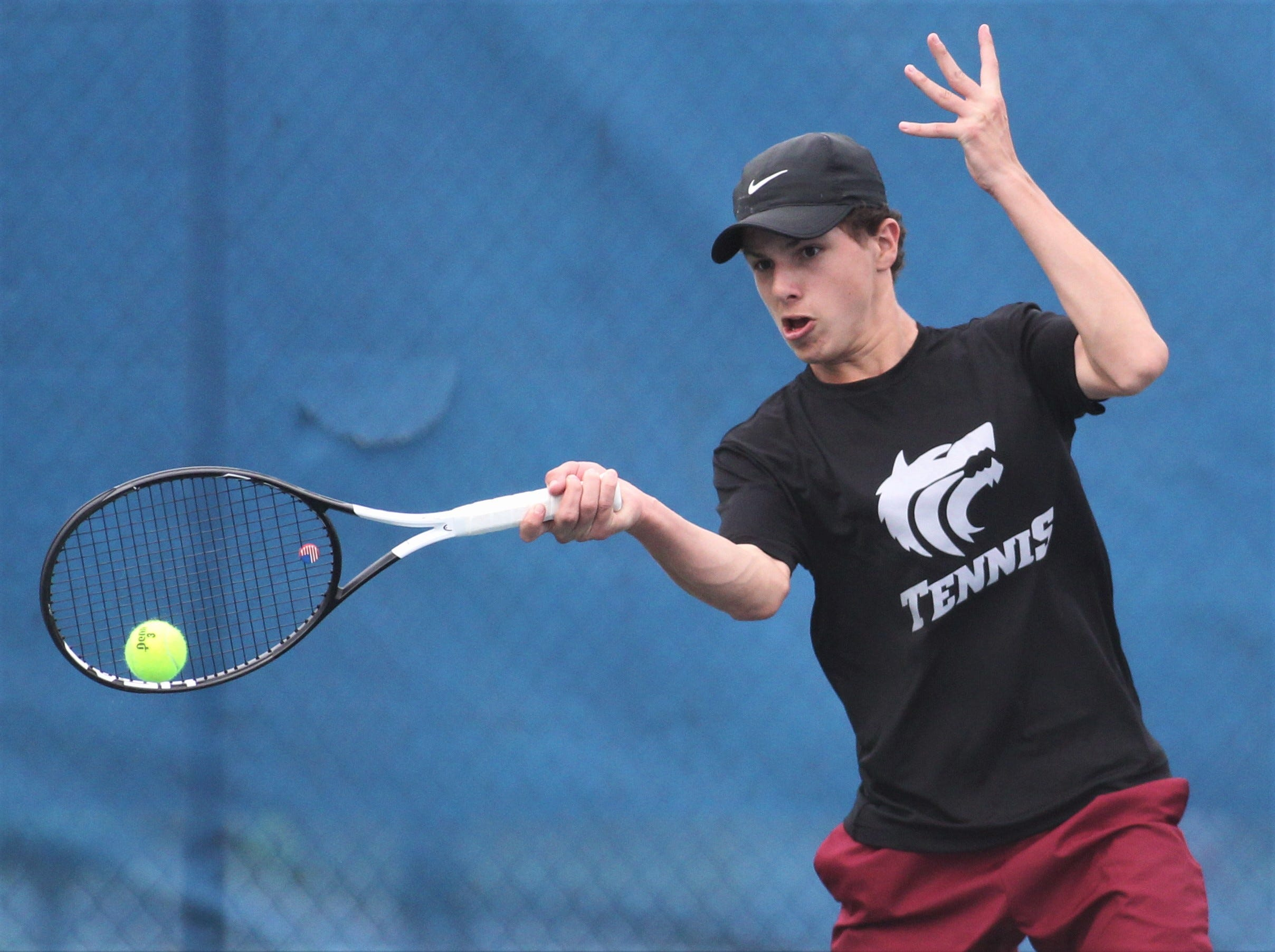 Chiles sophomore Chris DeCardenas plays during the high school boys and girls city tennis tournament at Tom Brown Park on Thursday, March 14, 2019.