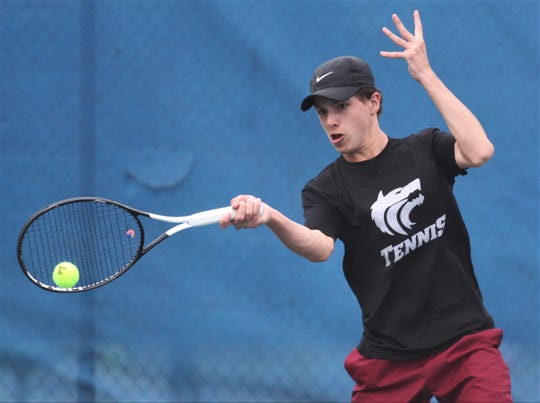 Chiles sophomore Chris de Cardenas plays during the high school boys and girls city tennis tournament at Tom Brown Park on Thursday, March 14, 2019.