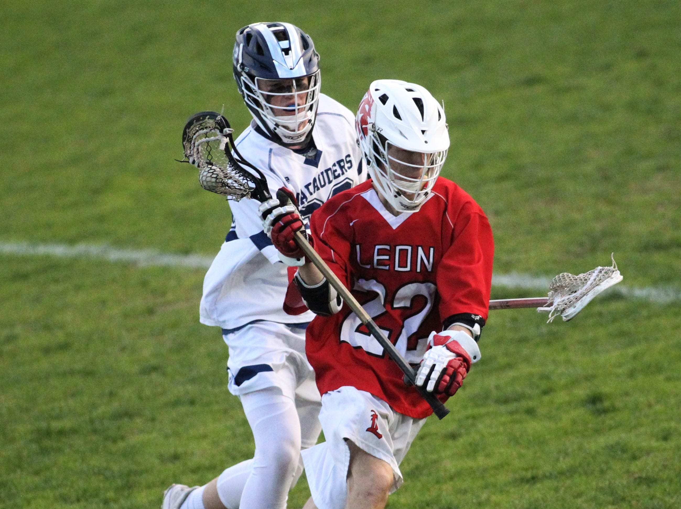 Leon's Shane Pichard tries to get free as the Marauders' lacrosse team beat Leon 15-5 on their annual Military Appreciation Night on March 12, 2019.