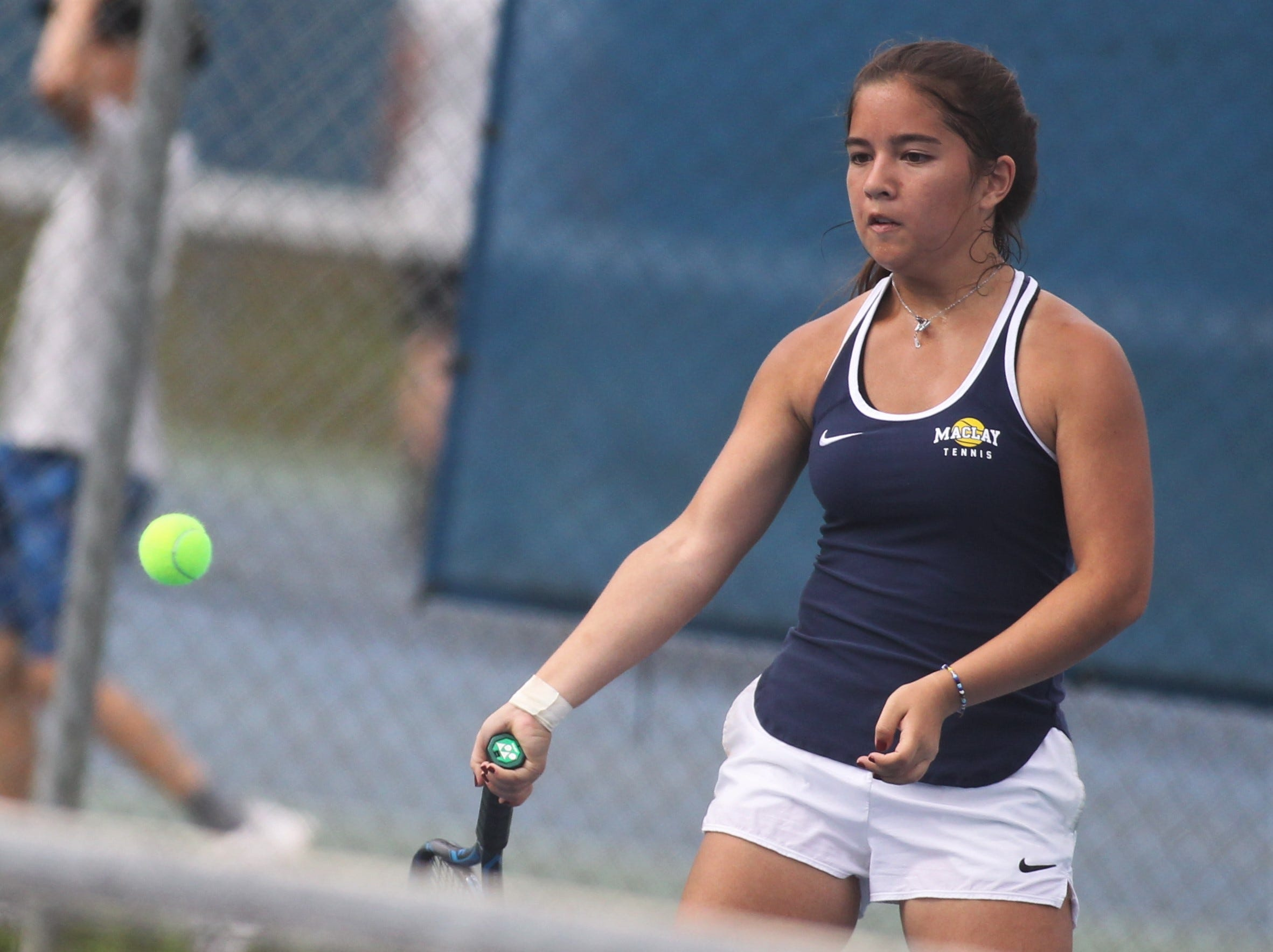 Maclay's Bella Snider plays during the high school boys and girls city tennis tournament at Tom Brown Park on Thursday, March 14, 2019.