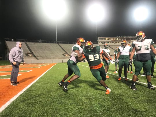 FAMU defensive lineman De'Montre Moore spins through a block during one-on-one drills at spring practice.
