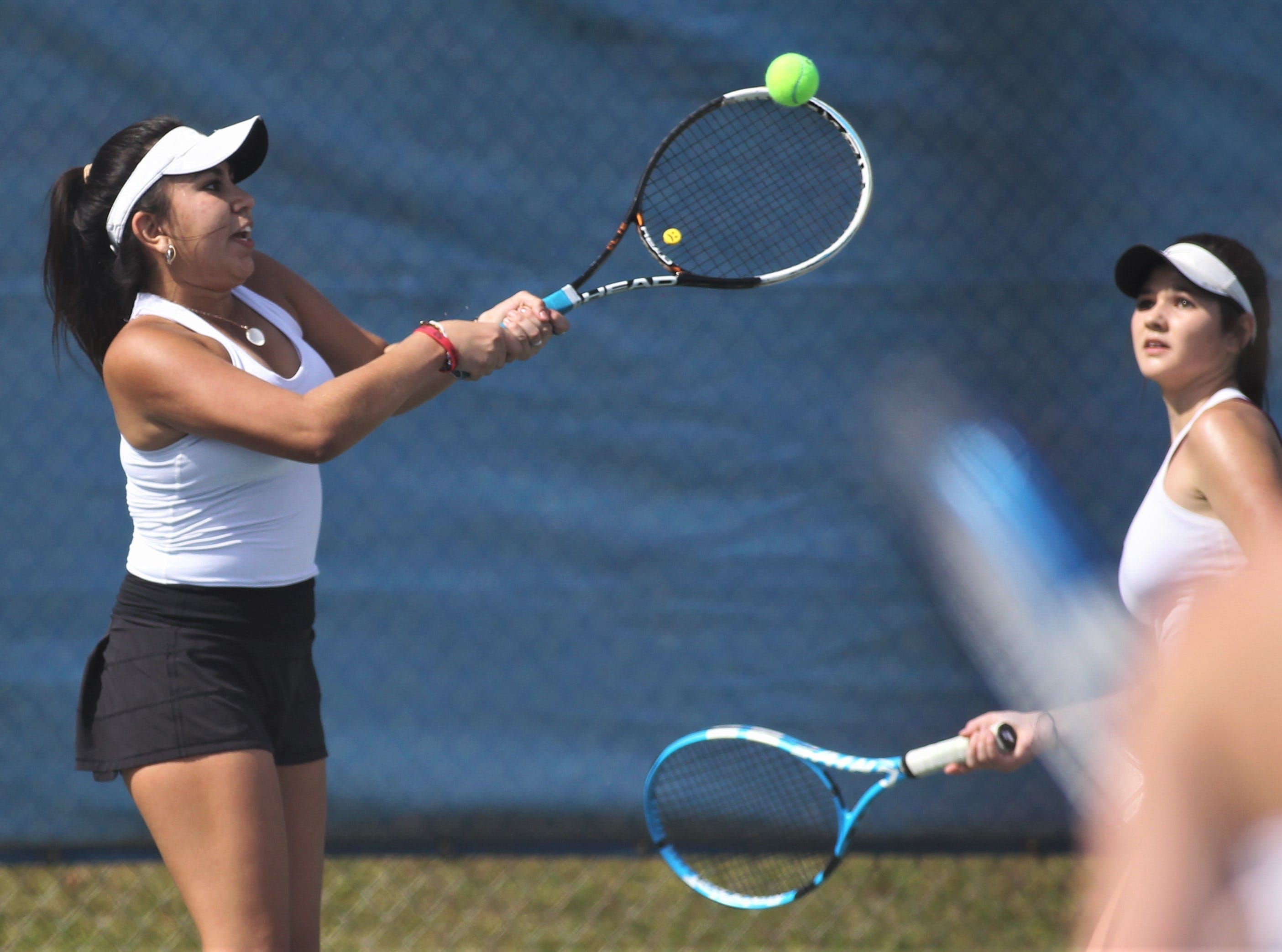 Chiles junior Sofia Guerrero plays doubles during the high school boys and girls city tennis tournament at Tom Brown Park on Thursday, March 14, 2019.