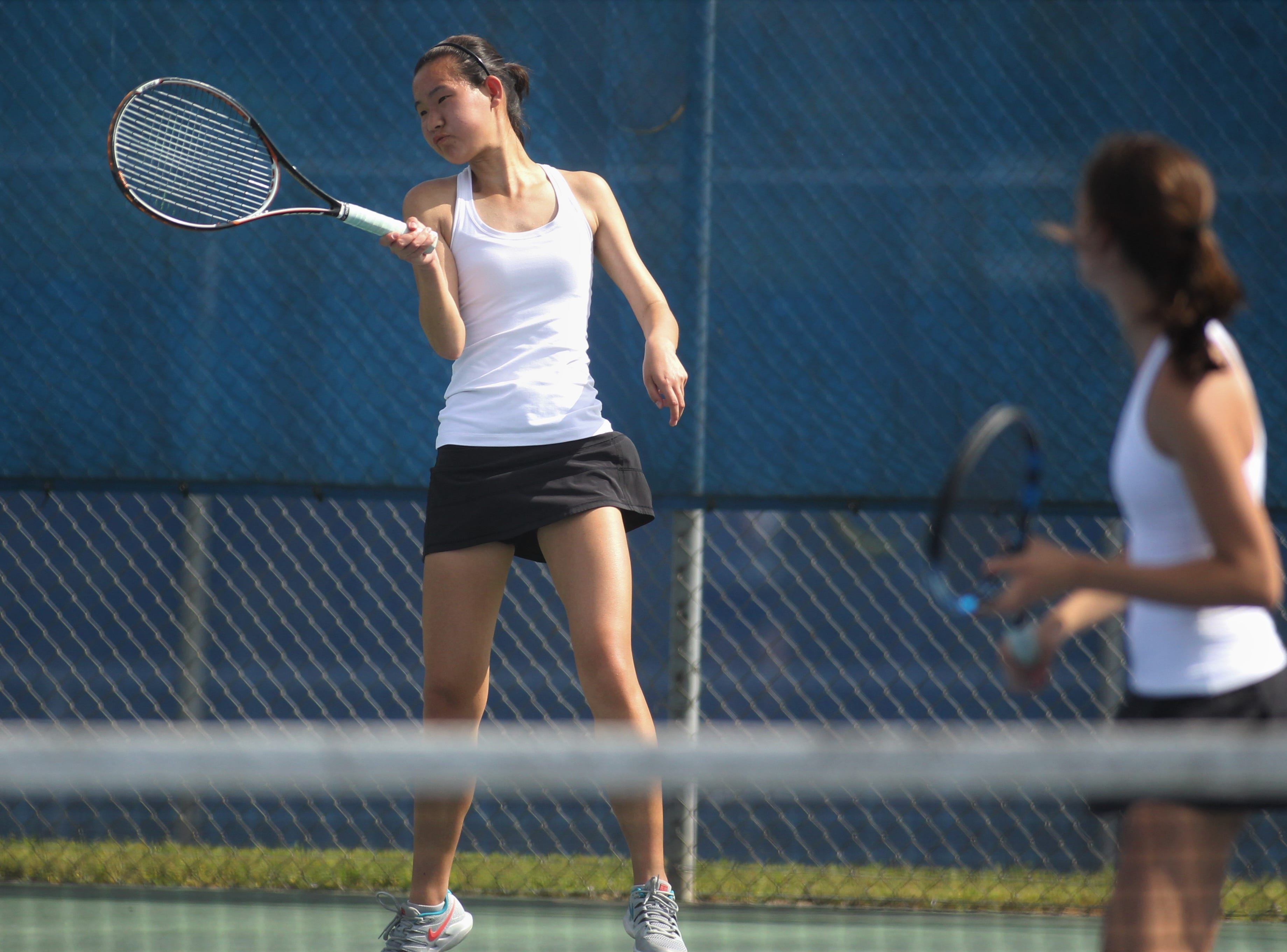 Chiles senior Amy Xia plays doubles during the high school boys and girls city tennis tournament at Tom Brown Park on Thursday, March 14, 2019.