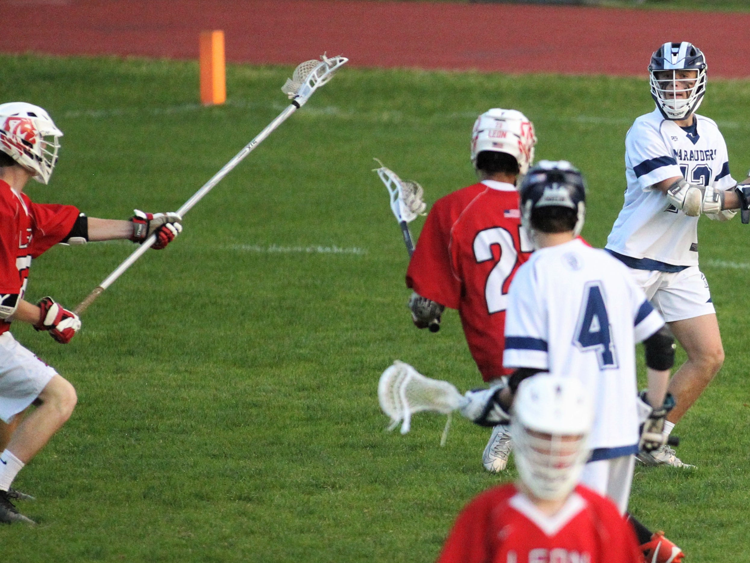 Maclay freshman Everett Thompson looks for a shot angle or a pass as the Marauders' lacrosse team beat Leon 15-5 on their annual Military Appreciation Night on March 12, 2019.