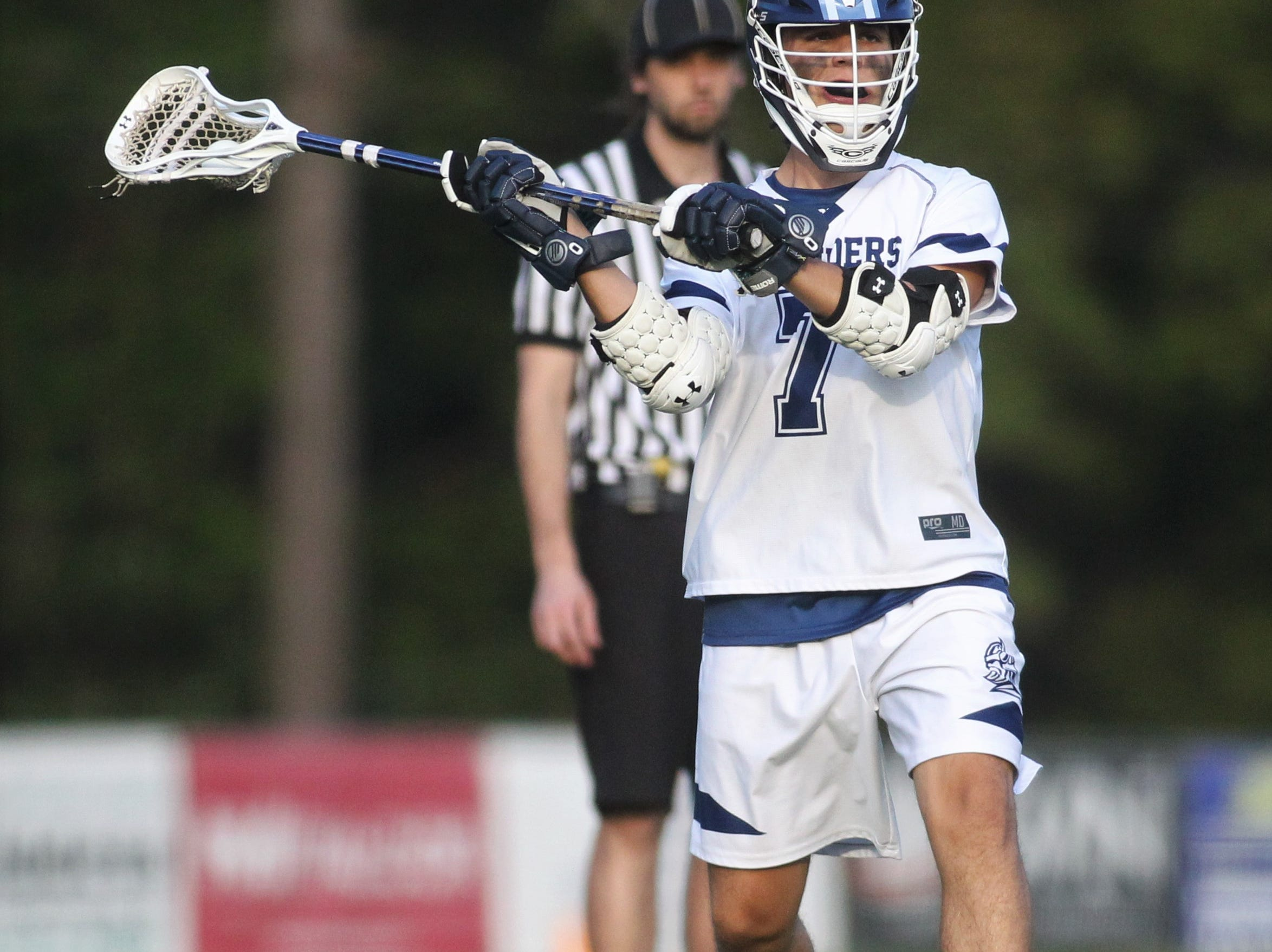 Maclay junior Nathan Sharkey looks for a pass as the Marauders' lacrosse team beat Leon 15-5 on their annual Military Appreciation Night on March 12, 2019.
