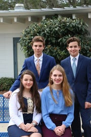 (From back left to bottom right): Hayden McDaniel, Collin Roberts, Madelyn Stout and Madeleine Roberts created an investment team that was selected to compete in a regional competition at The University of Pennsylvania's Wharton School of Business.