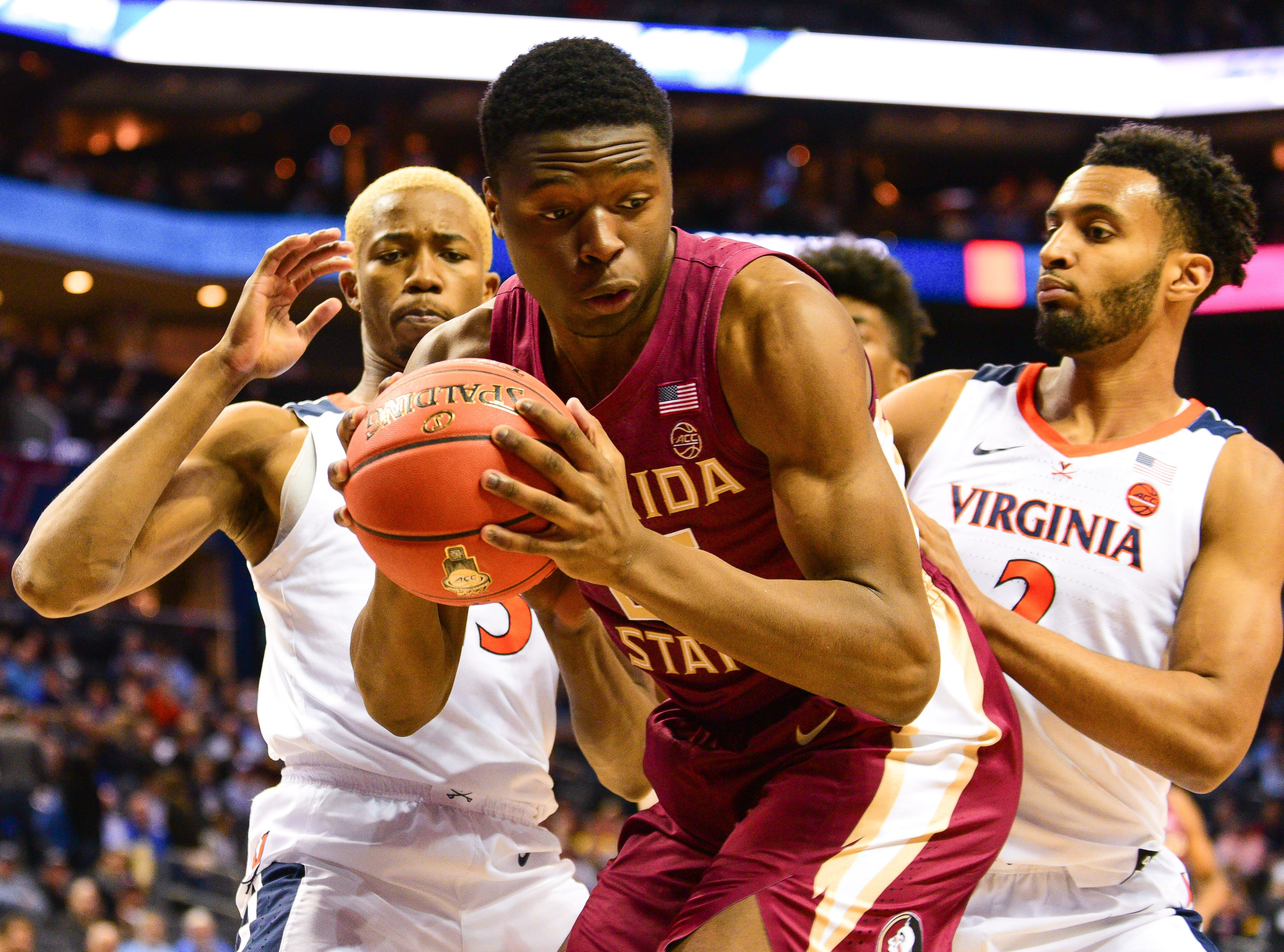 Surrounded by Virginia defense, Florida State redshirt sophomore forward Mfiondu Kabengele considers another strategy during the first half of the ACC Tournament Semifinals at the Spectrum Center in Charlotte on Friday.