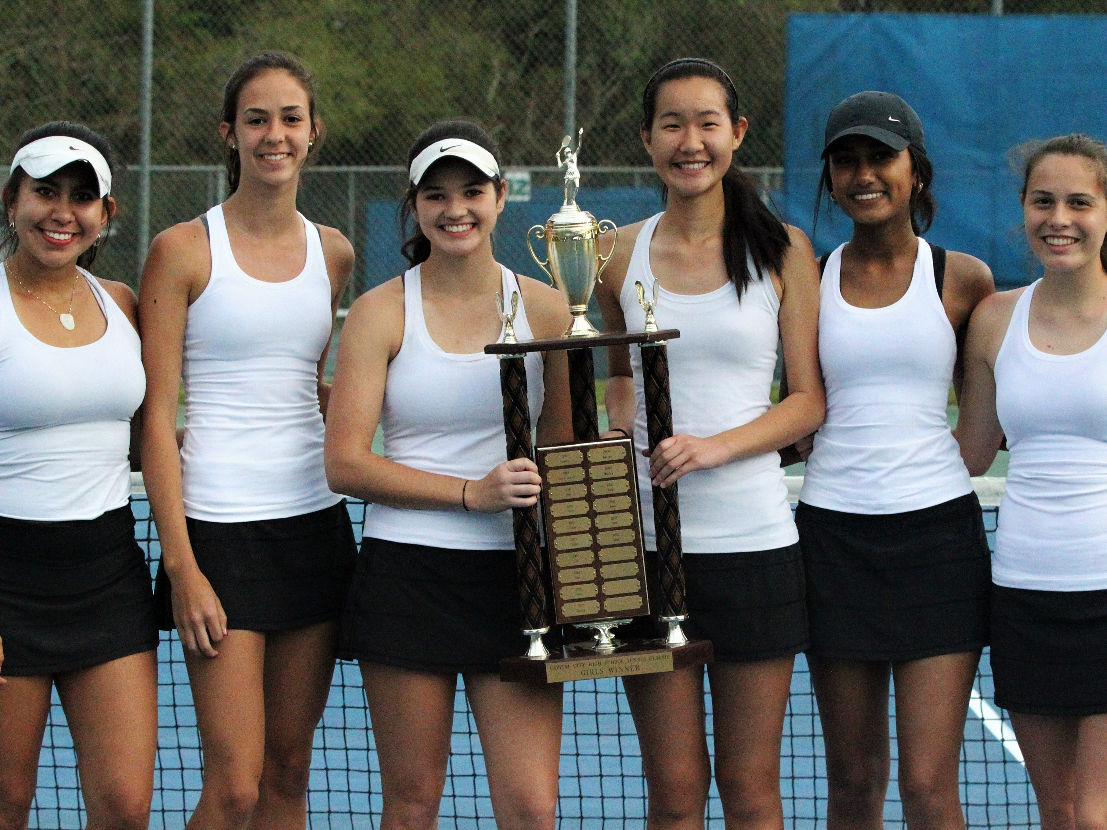 Chiles' girls tennis team won its fifth straight district championship during the high school boys and girls city tennis tournament at Tom Brown Park on Thursday, March 14, 2019. Senior Gracie Wilson (third from left) won a city title at No. 1.