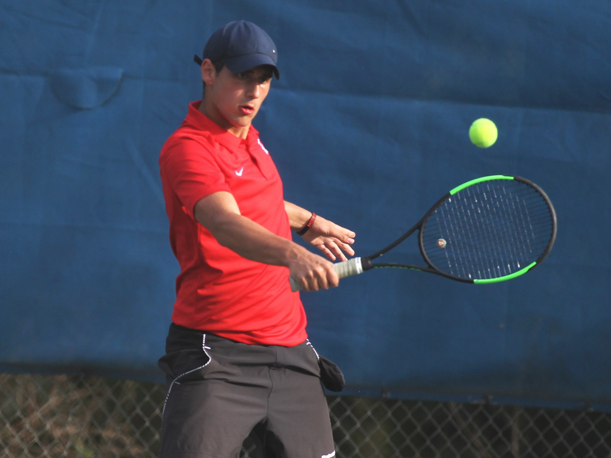 Leon's Petar Leontikj plays during the high school boys and girls city tennis tournament at Tom Brown Park on Thursday, March 14, 2019.