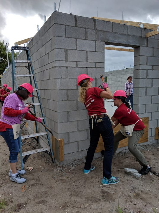Bank of America employees Fabiola Brumley, left, Denise Ehrich and Joey Deloa Davis participate in the Habitat for Humanity of Palm Beach County Women's Build project in Jupiter on March 8.