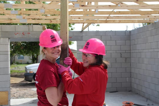 Bank of America employees Laura Messler and Fabiola Brumley participate in the Habitat for Humanity of Palm Beach County Women's Build project in Jupiter on March 8.