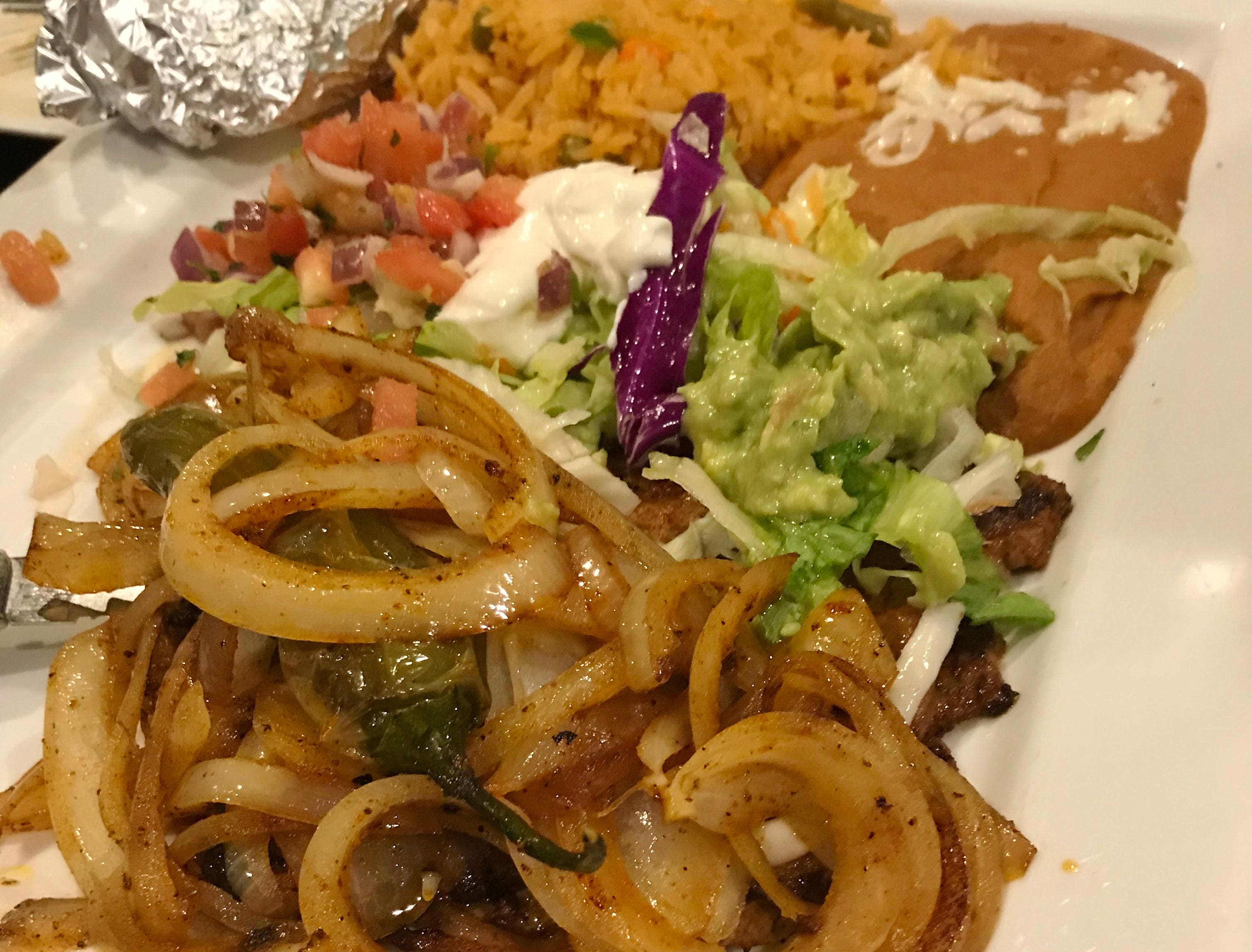 The Carne Asada had a tender slice of rib eye smothered with grilled onions.