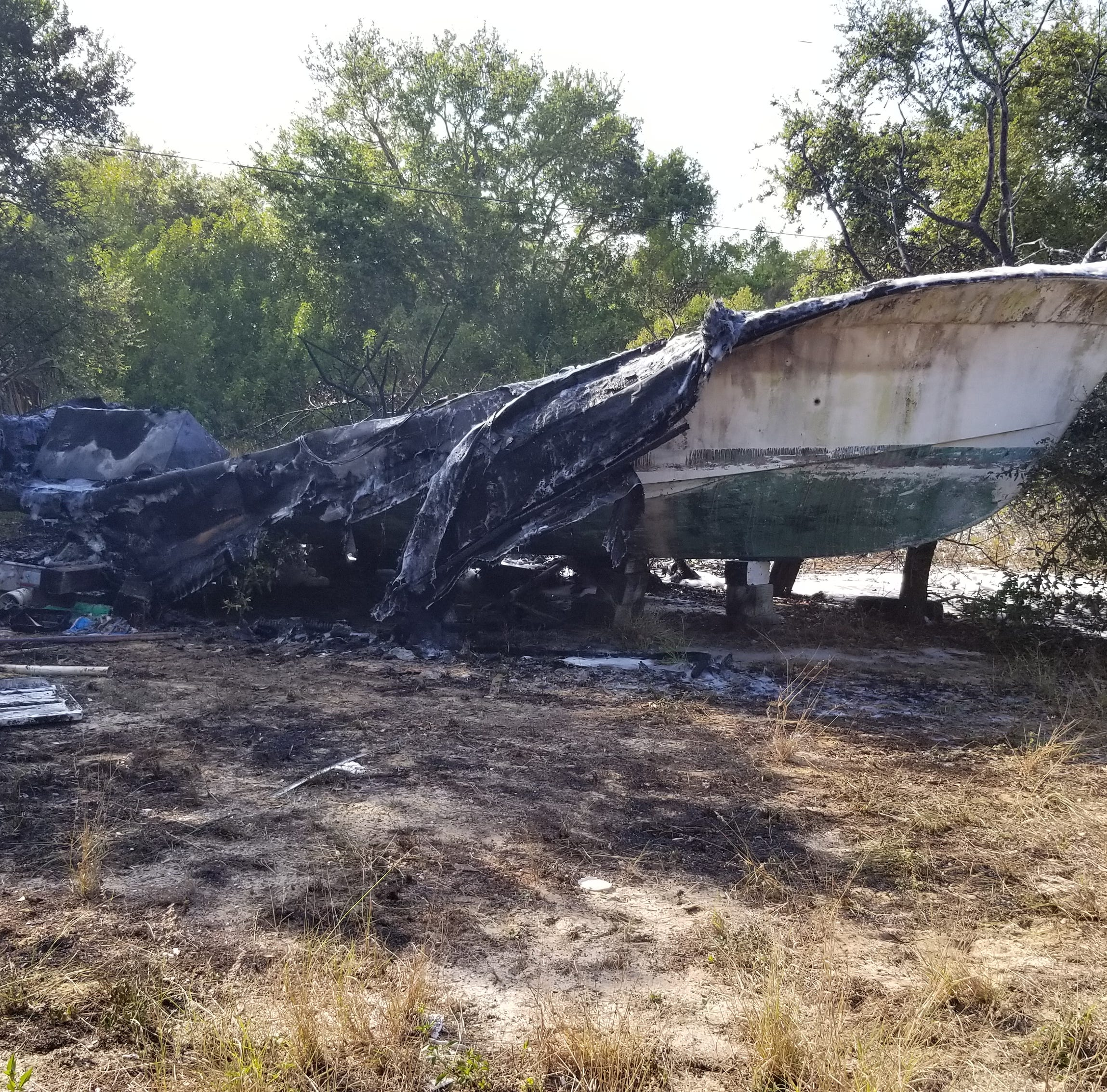 Abandoned boat on fire in Sebastian after reported explosion, thick black smoke in area
