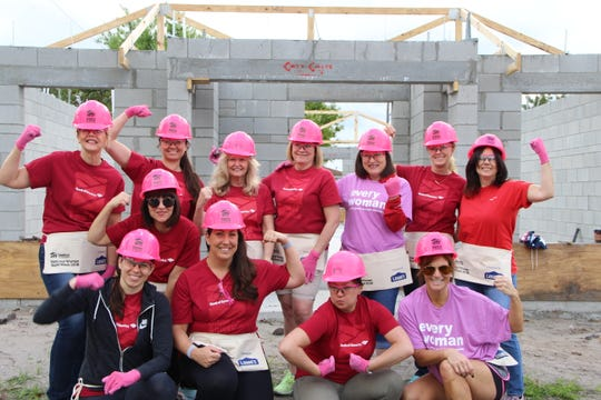 Bank of America employees helping at the Habitat for Humanity of Palm Beach County Women's Build project in Jupiter are, from left, front row, Nikki Morley, Karen Wong, Stephanie Glavin, Joey Deloa Davis and Tracey Cooper; back row, Laura Messler, Stephanie Kearley, Robin Henderson, Alisa Perez, Fabiola Brumley, Denise Ehrich and Anne Laureano.