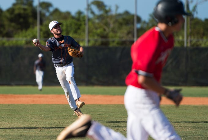 Lincoln Park Academy second-baseman Robert Hofher throws out Port St. Lucie's Michael Williams for the first out in the bottom of the seventh inning of the high school baseball game Thursday, March 14, 2019, at Port St. Lucie High School.